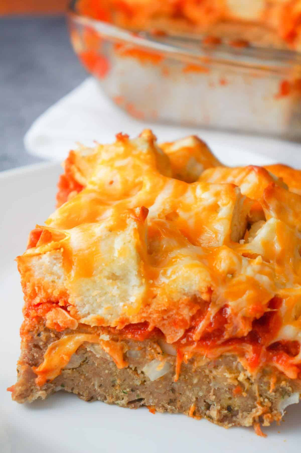 Easy Ground Chicken Casserole is a hearty ground chicken recipe topped with marinara sauce, garlic bagel chunks and shredded cheese.