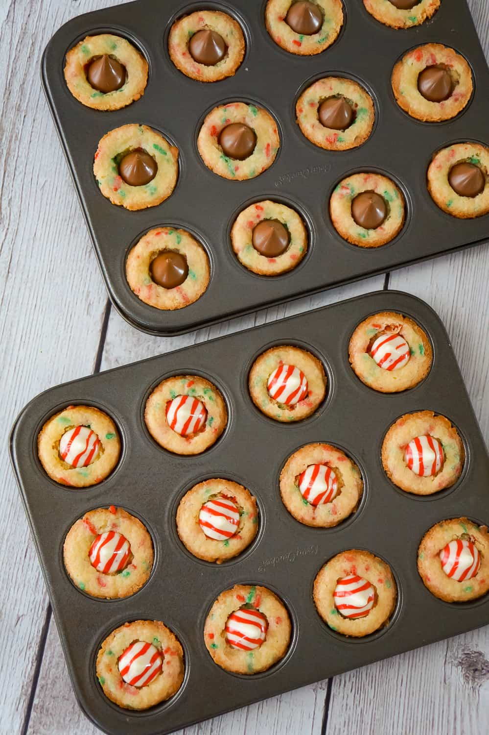 Christmas Sugar Cookie Cups with Hershey's Kisses in mini muffin tins.