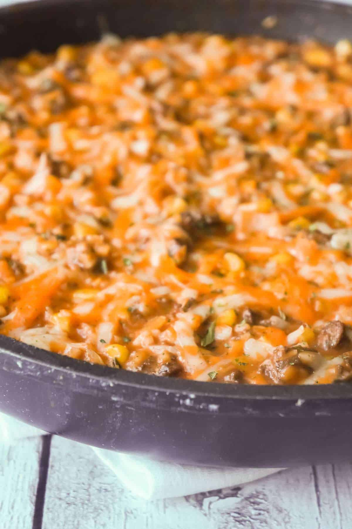 Cheesy Tomato Ground Beef and Rice is an easy ground beef dish loaded with corn, cheese and rice all tossed in a creamy tomato sauce.