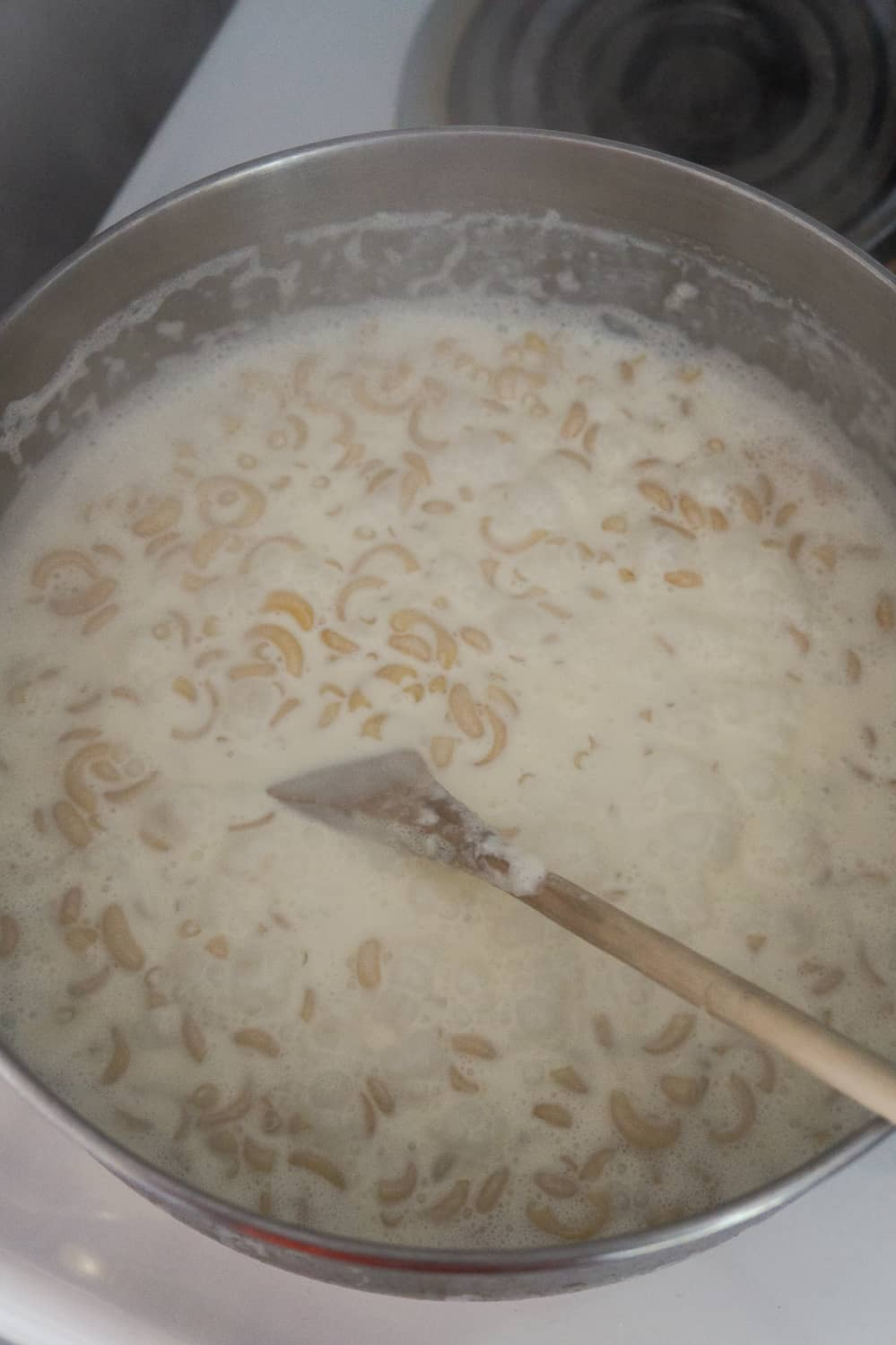 macaroni noodles and heavy cream in a saucepan