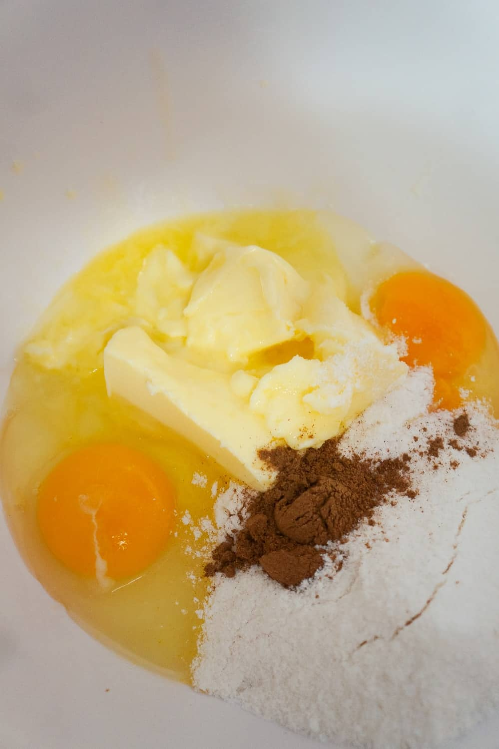 eggs, butter, pumpkin pie spice and vanilla pudding mix in mixing bowl