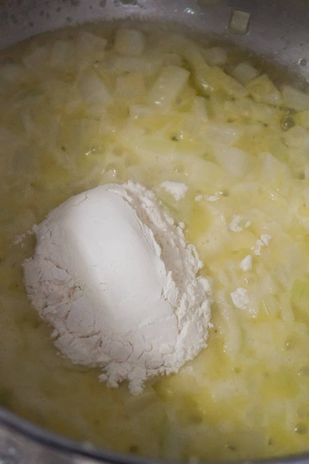 flour added to diced onions and butter in soup pot