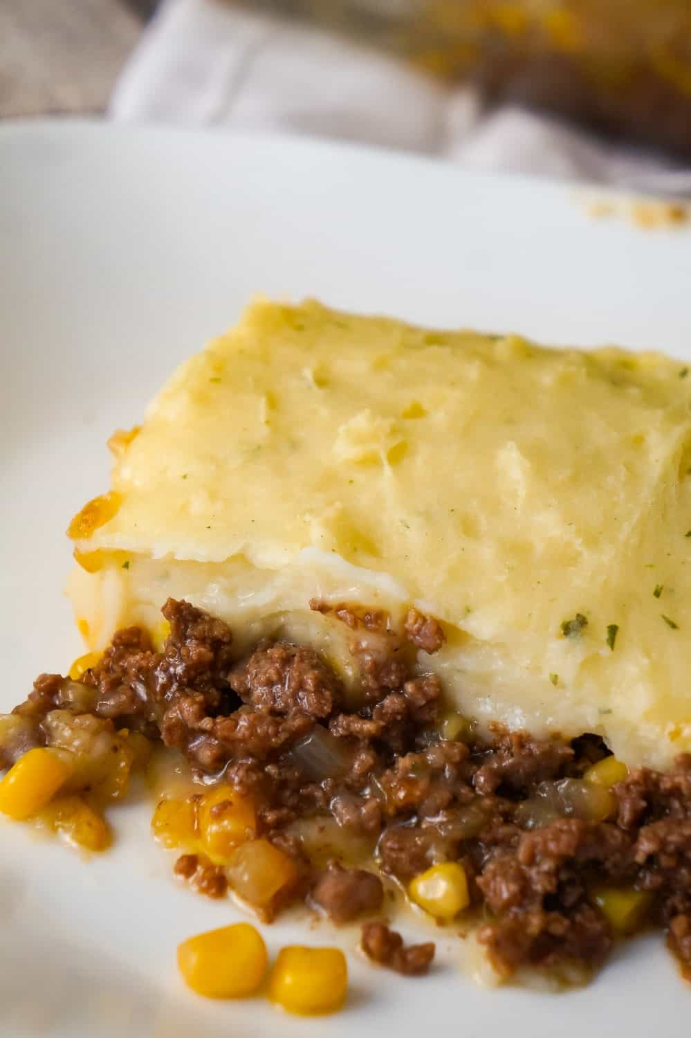The Best Shepherd's Pie is an easy ground beef dinner recipe. A base of ground beef tossed in brown gravy is topped with corn and creamy mashed potatoes.