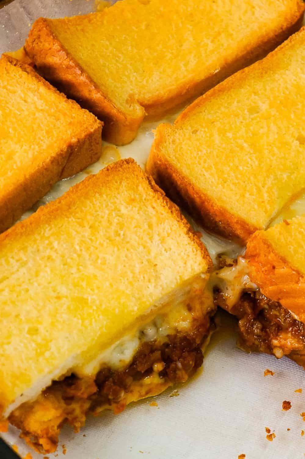 Sloppy Joe Grilled Cheese Casserole is an easy ground beef dinner recipe your whole family will love. This tasty casserole is loaded with mozzarella cheese and sloppy joe filling sandwiched between two layers of bread.