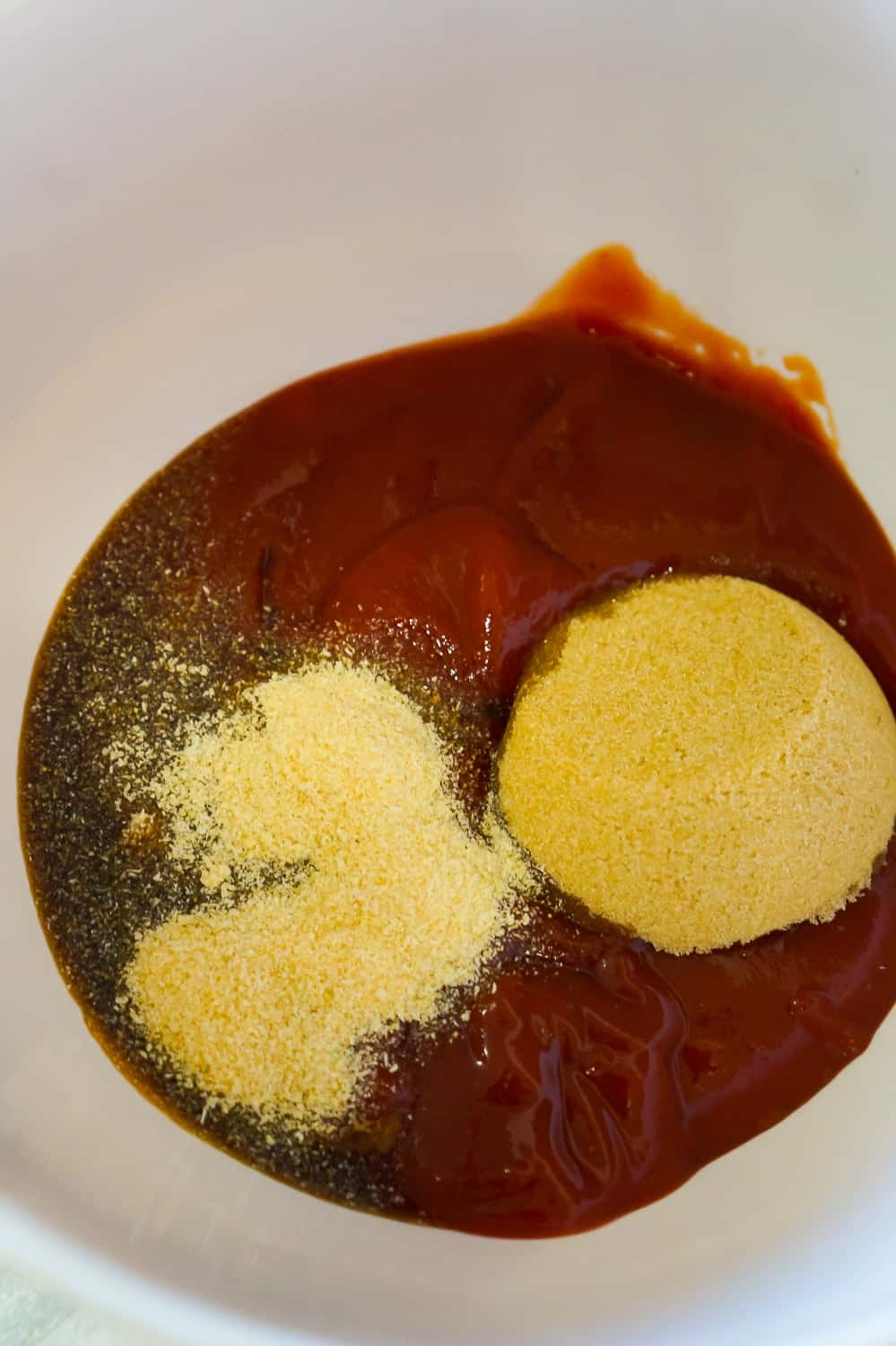 ketchup, Worcestershire sauce, onion powder, brown sugar, in a mixing bowl