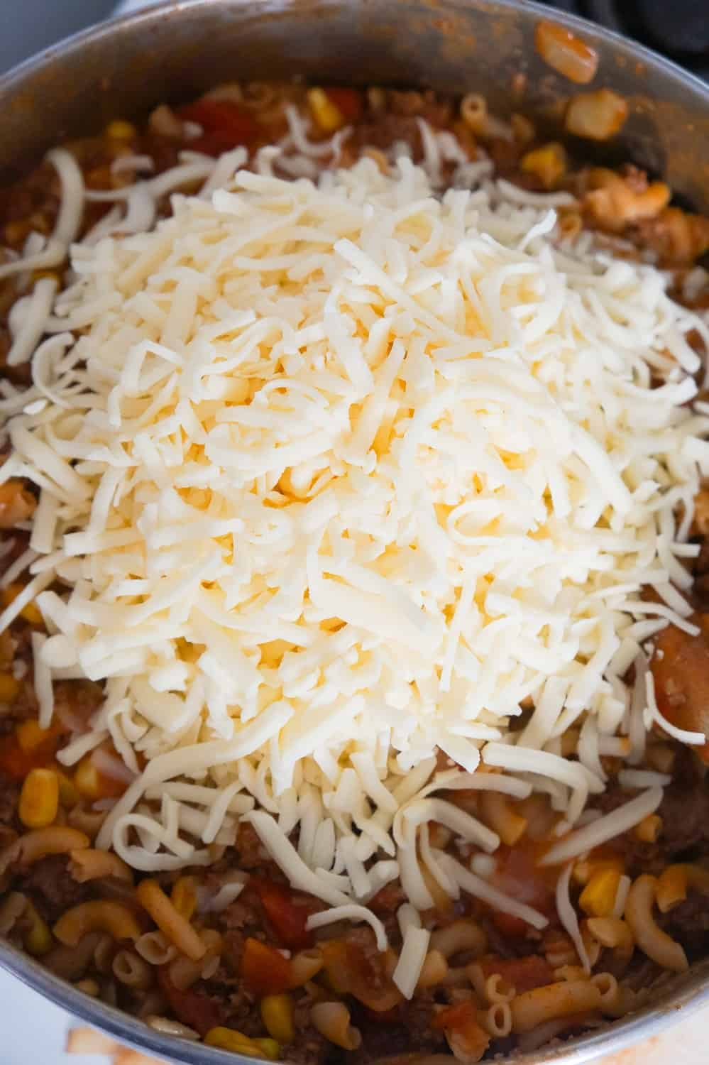 shredded mozzarella cheese on top of beef goulash