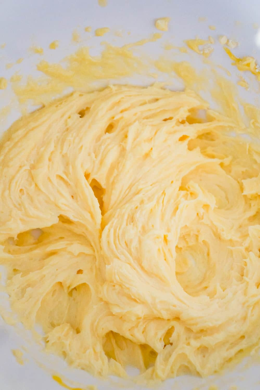 butter, eggs and vanilla instant pudding mix creamed together in a mixing bowl