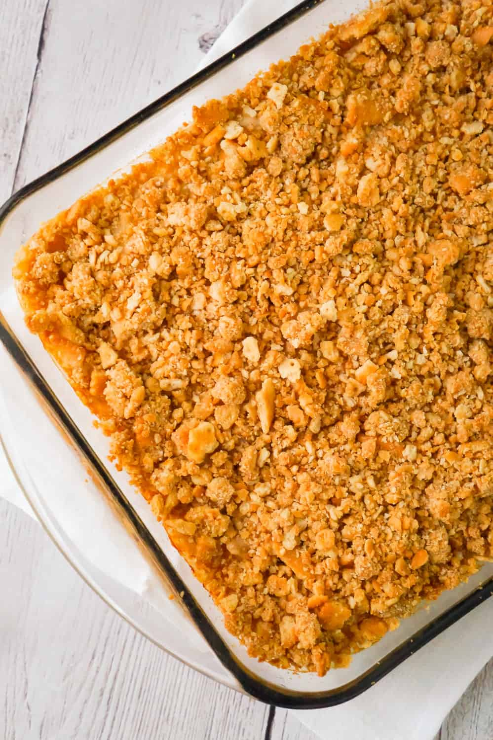 Easy Chicken and Rice Casserole is a hearty dinner recipe perfect for cold weather. This delicious chicken casserole is loaded with long grain rice, Campbell's cream of chicken soup, corn and topped with crumbled Ritz crackers.