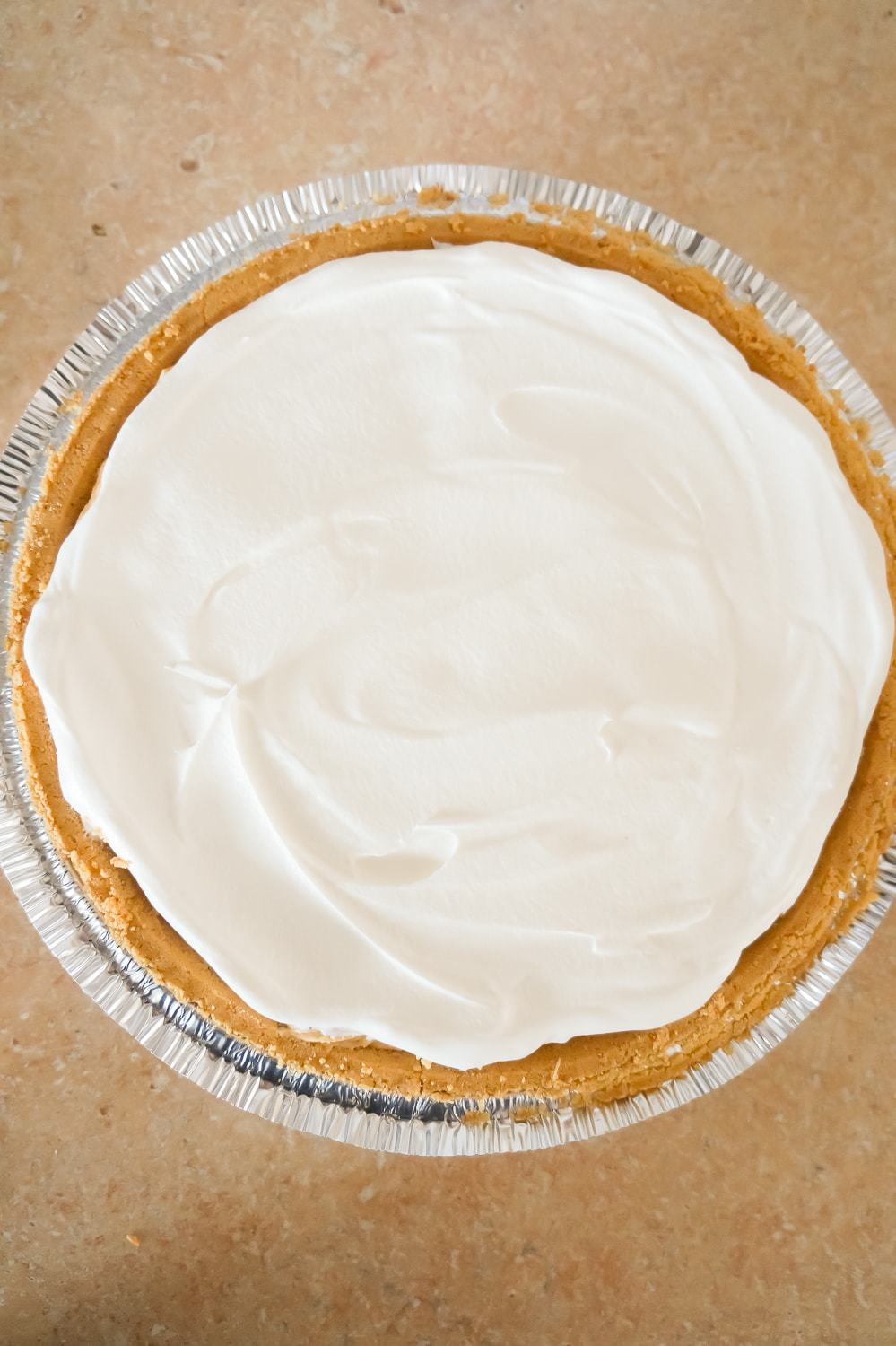 Cool Whip spread on top of peanut butter pie