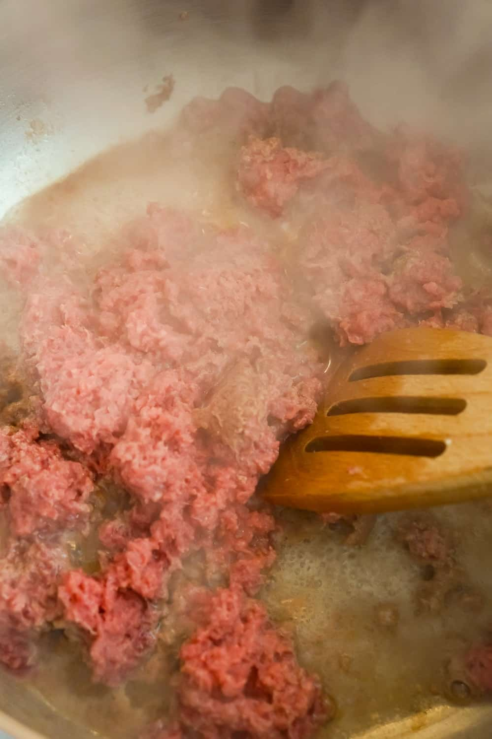 ground beef cooking in a pot