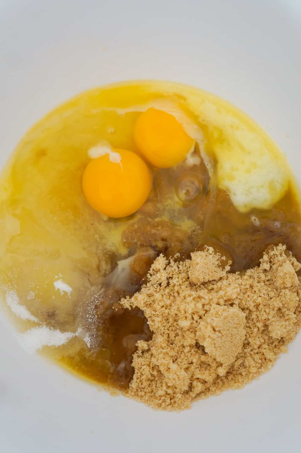 eggs, melted butter, brown sugar and granulated sugar in a mixing bowl