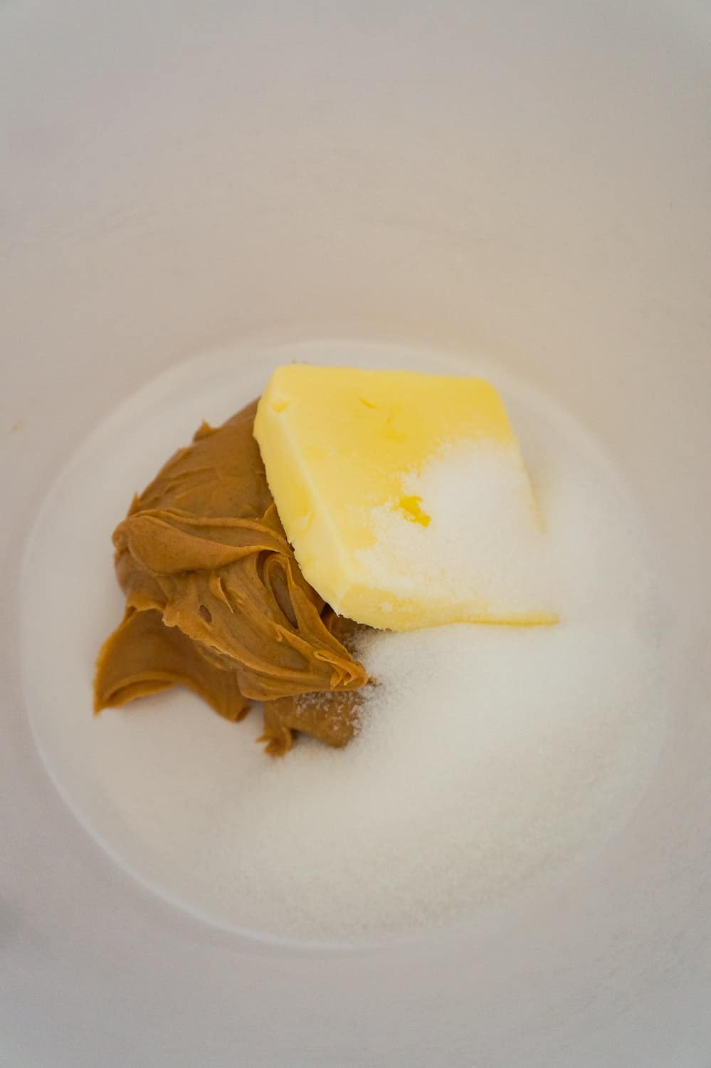 softened butter, peanut butter and granulated sugar in a mixing bowl
