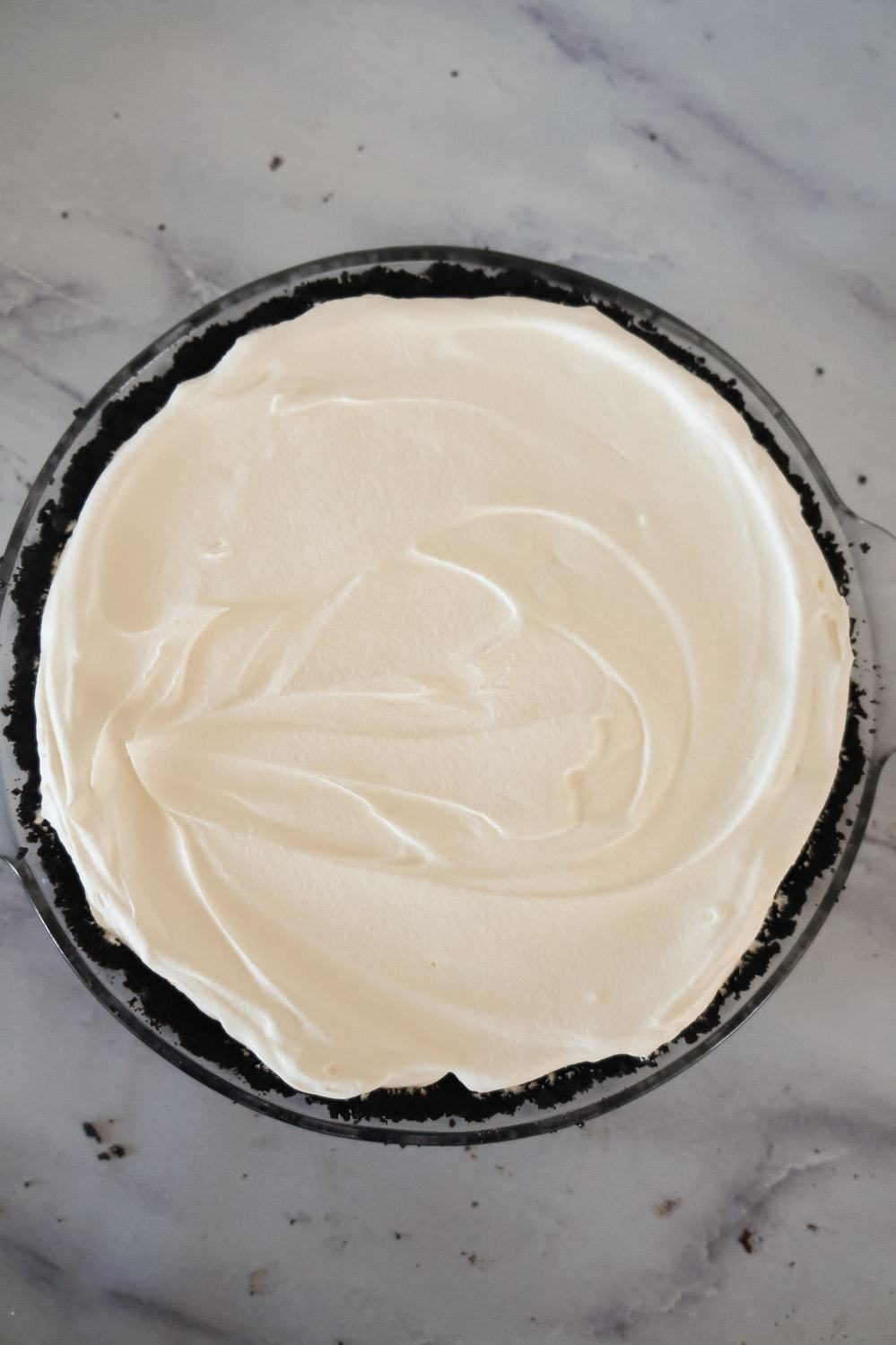 Cool Whip spread on top of Oreo pie