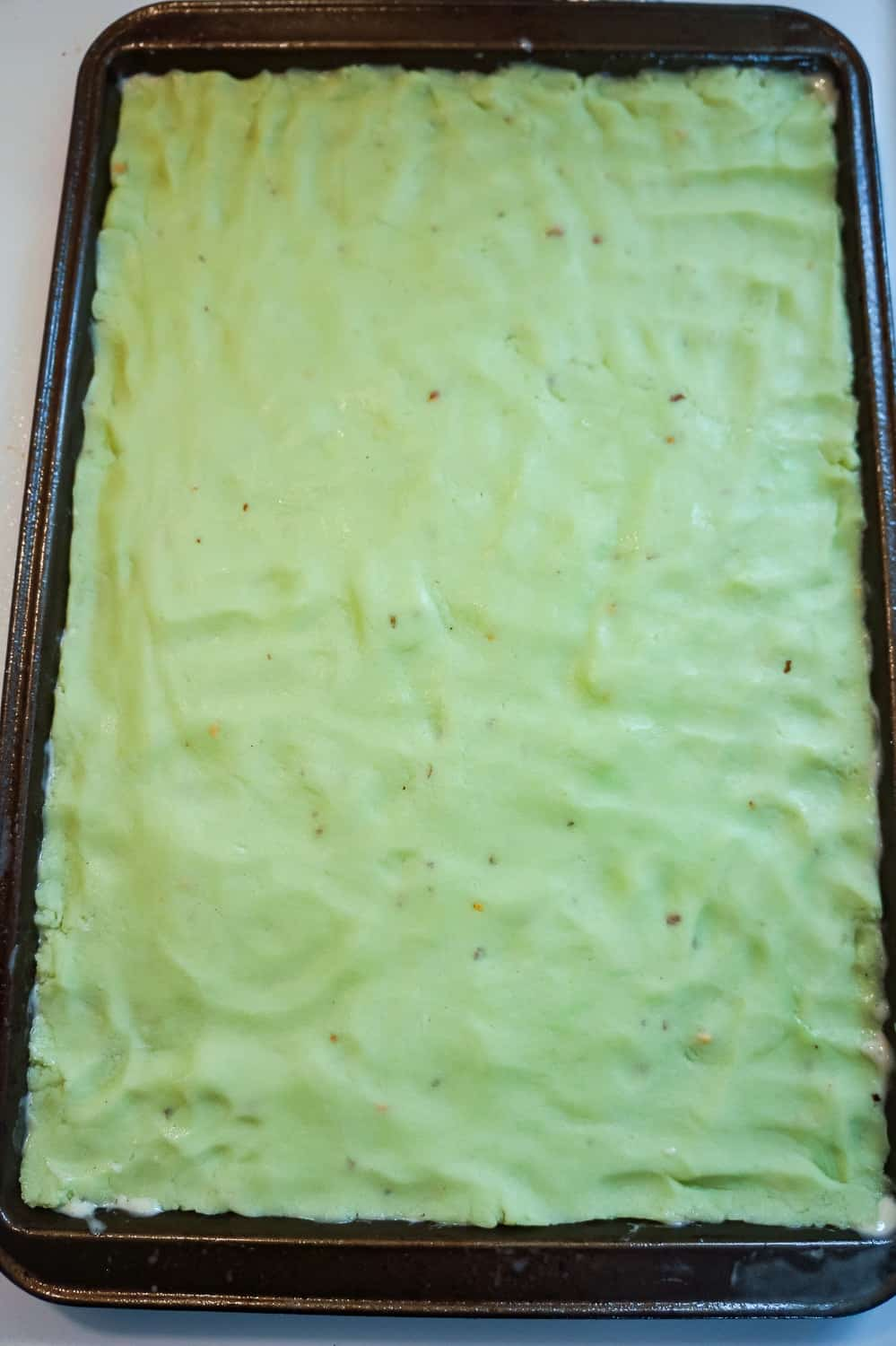 pistachio pudding sugar dough pressed out in baking sheet
