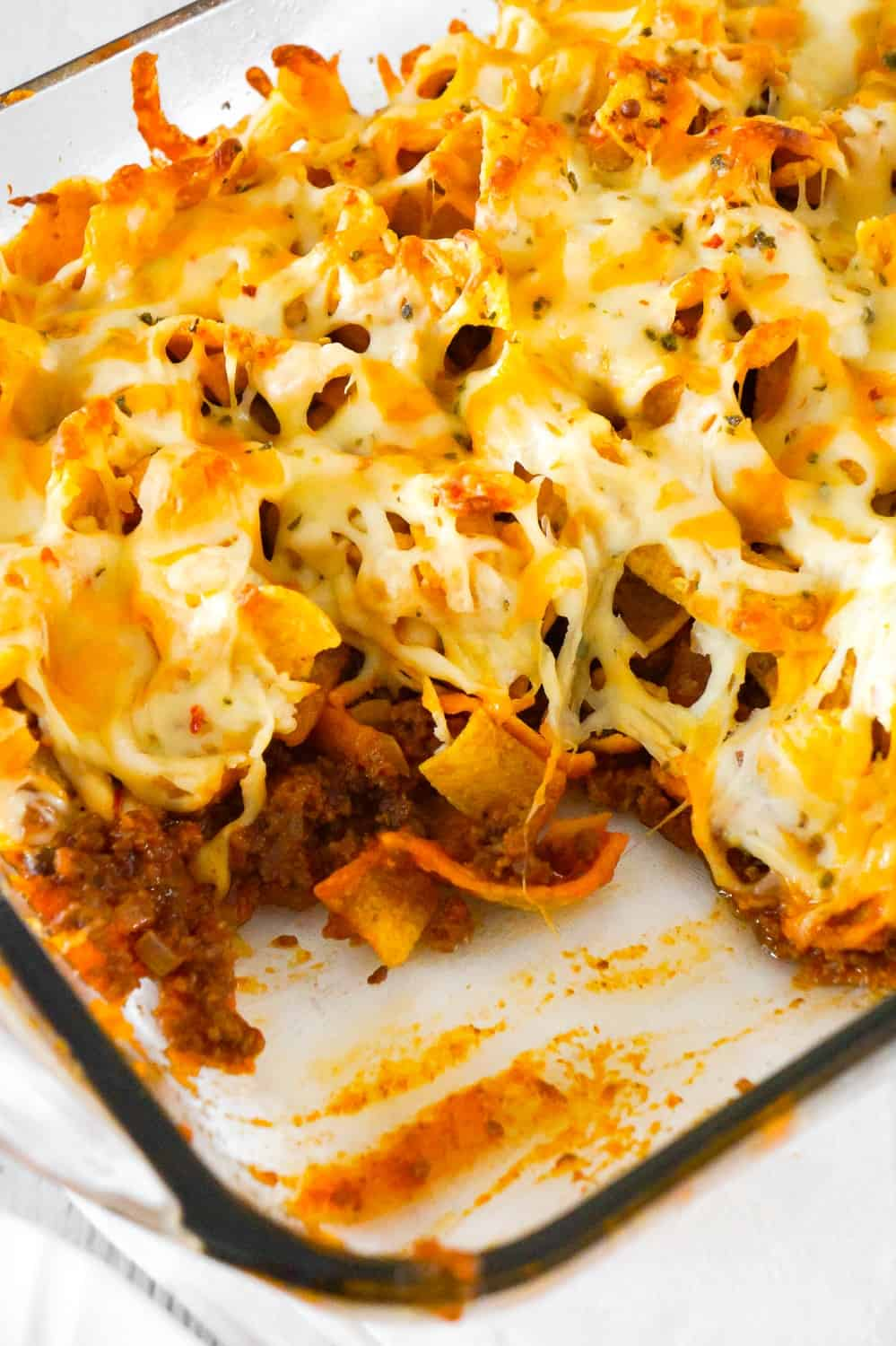Sloppy Joe Frito Pie is an easy ground beef dinner recipe perfect for weeknights. Ground beef and onions are tossed in homemade sloppy joe sauce and then topped with Frito's corn chips and cheddar cheese.