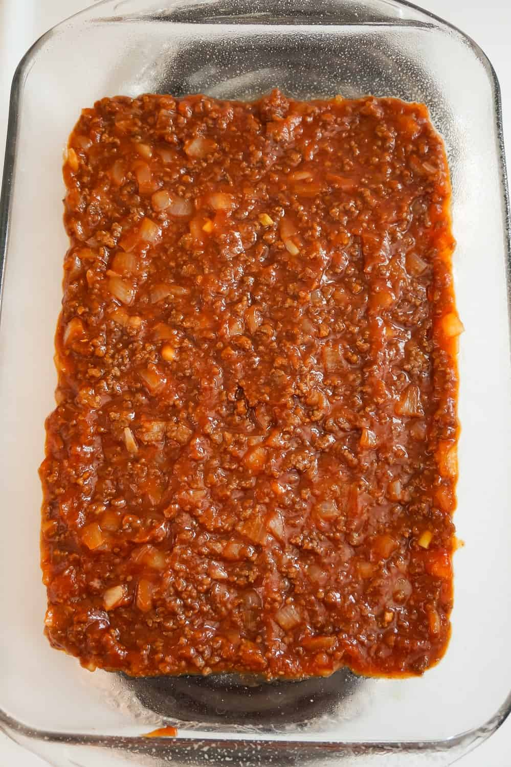 sloppy joe mixture in the bottom of a baking dish