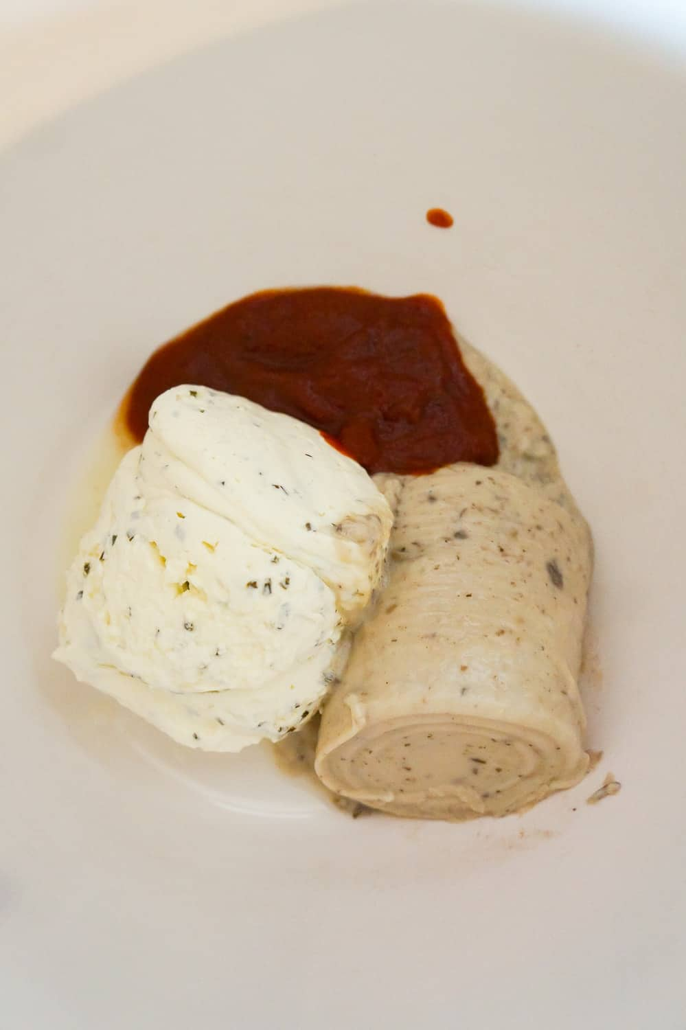 cream cheese, cream of mushroom soup and Heinz chili sauce in a mixing bowl