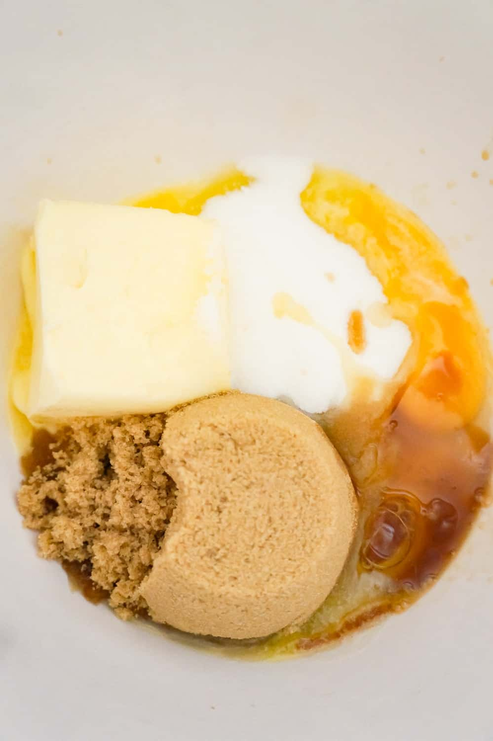 brown sugar, granulated sugar, softened butter, vanilla extract and an egg in a mixing bowl