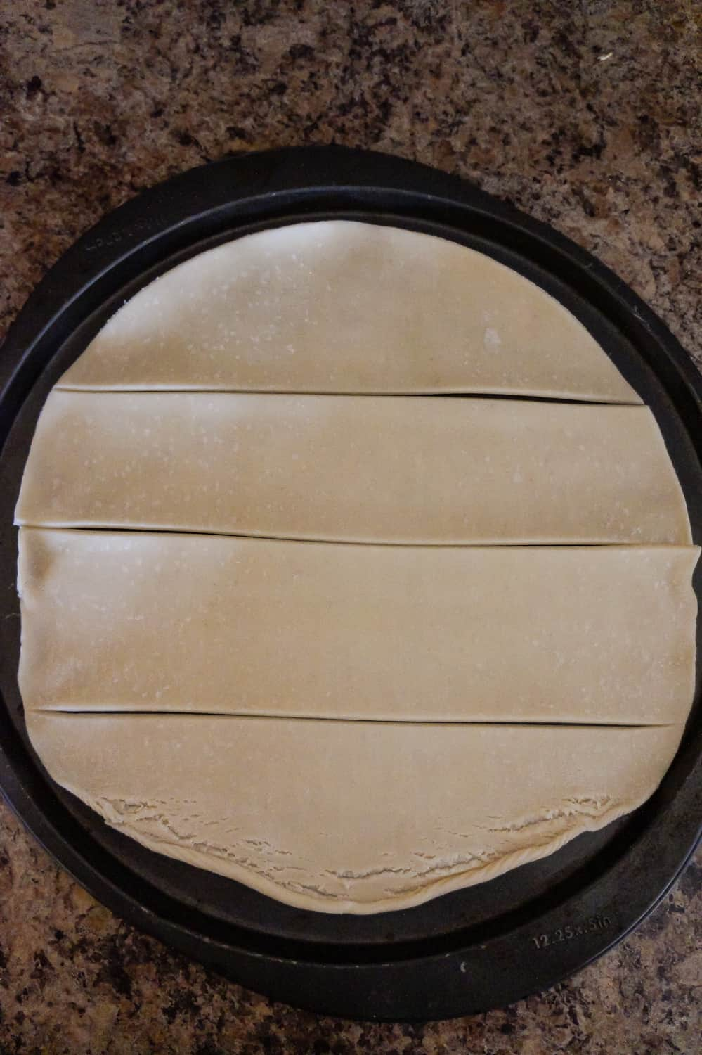Pillsbury pie crust dough cut into four wide strips