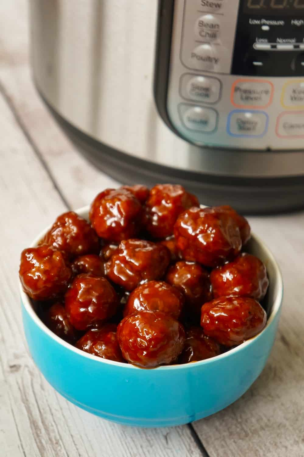 Instant Pot Grape Jelly Meatballs are the perfect party food. These tasty meatballs are coated in Welsh's Grape Jelly and Sweet Baby Ray's Hickory and Brown Sugar BBQ Sauce.