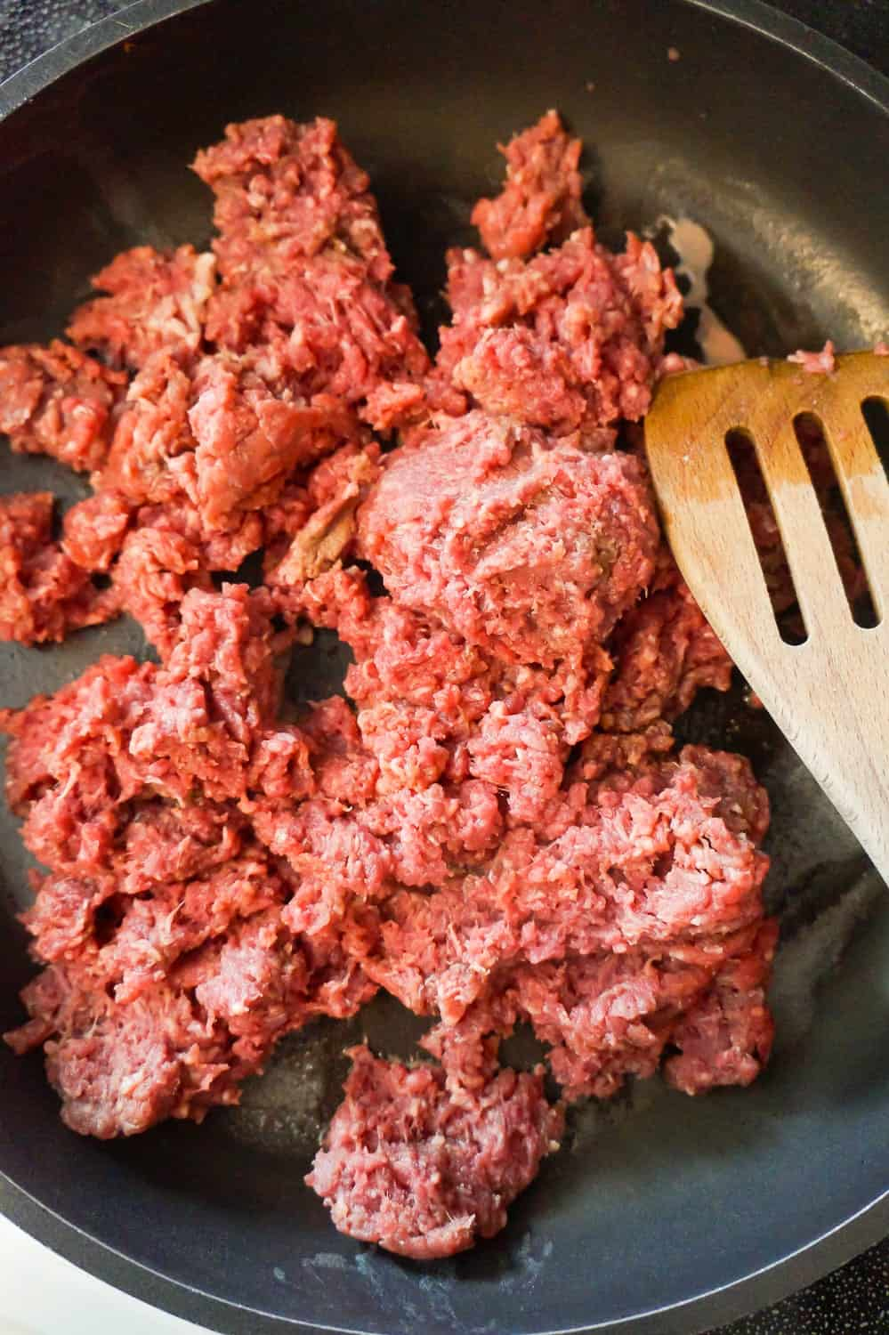 raw ground beef in a frying pan