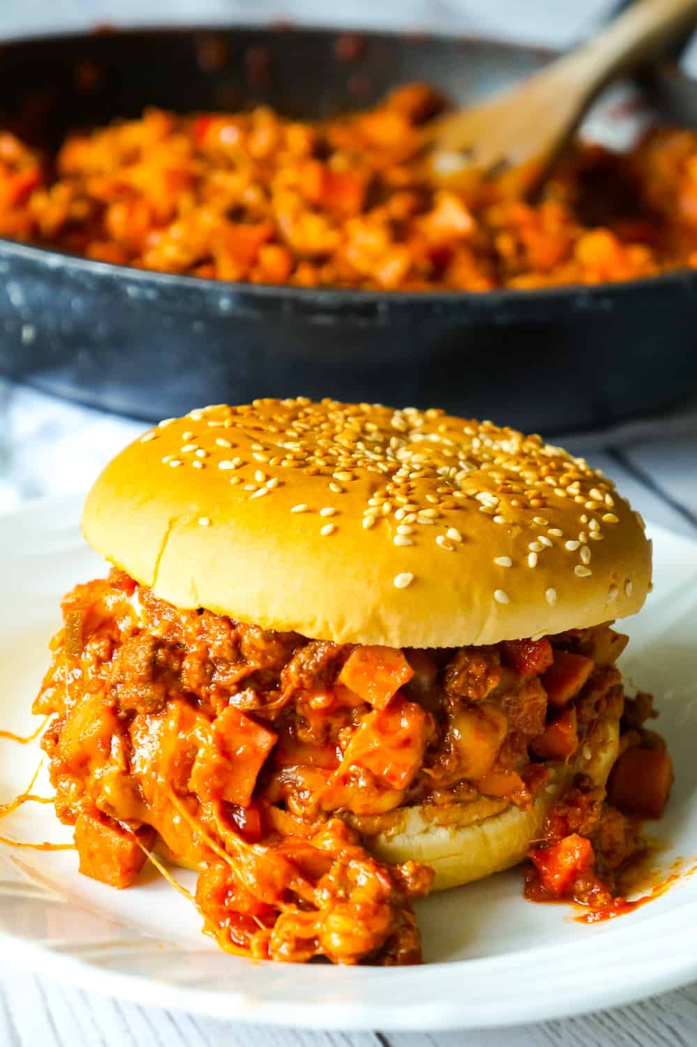 Chili Cheese Dog Sloppy Joes are an easy ground beef dinner recipe perfect for weeknights. These homemade sloppy joes are loaded with chopped wieners, shredded cheese, and onions all tossed in a chili sauce with a bit of a kick.