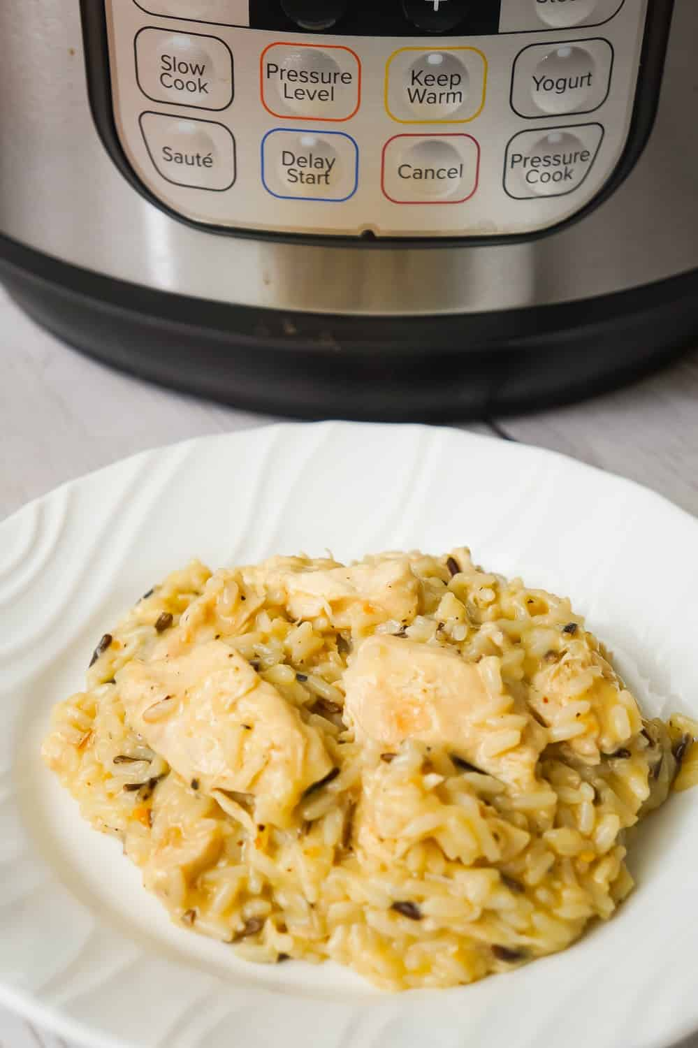 Instant Pot Lemon Pepper Chicken and Rice is an easy and delicious chicken dinner recipe. This creamy long grain and wild rice dish is loaded with tender chicken breast chunks.