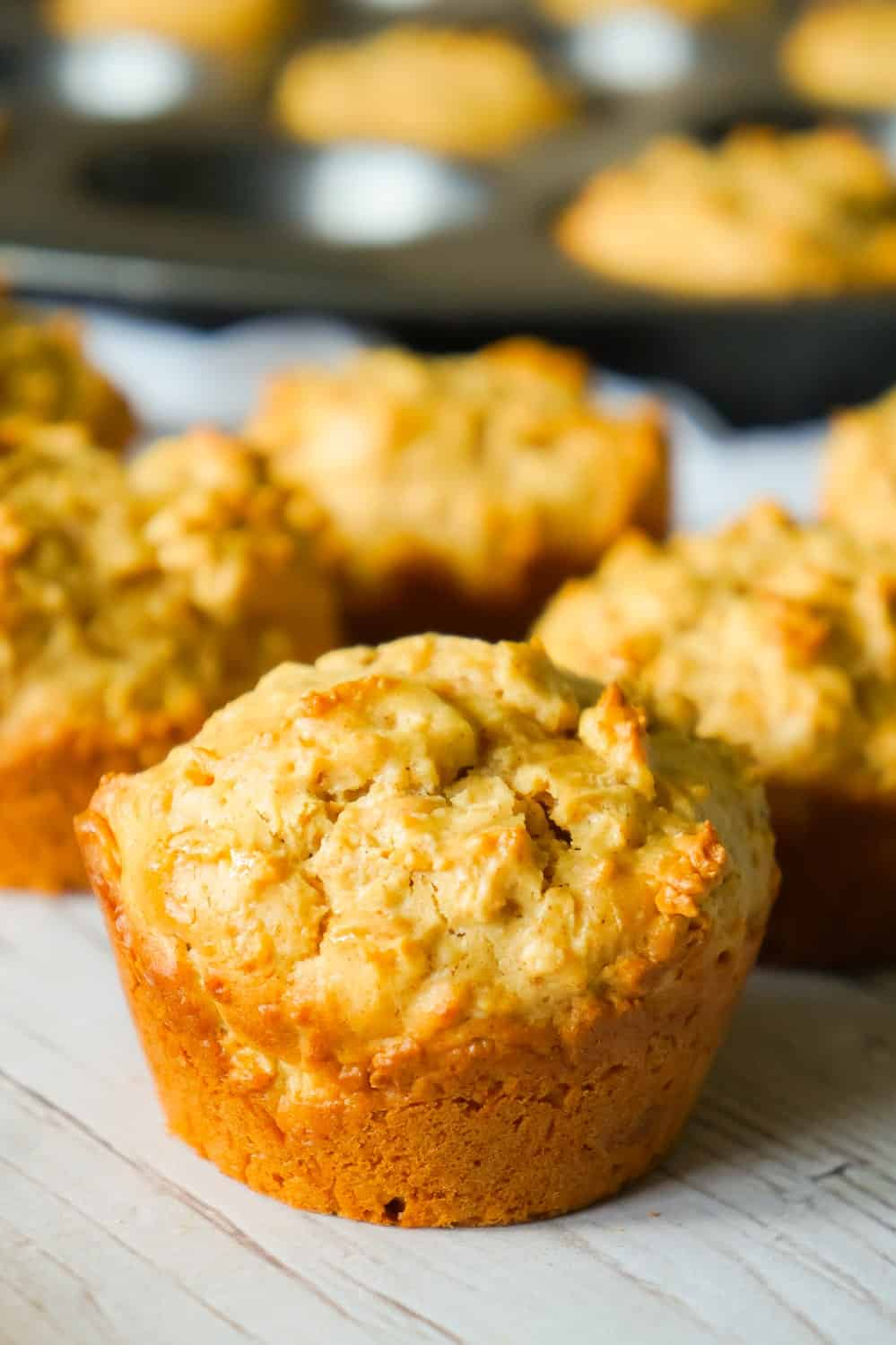 Pumpkin Spice Peanut Butter Oatmeal Muffins are a delicious fall treat loaded with pumpkin pie spice, smooth peanut butter and Reese's peanut butter baking chips.