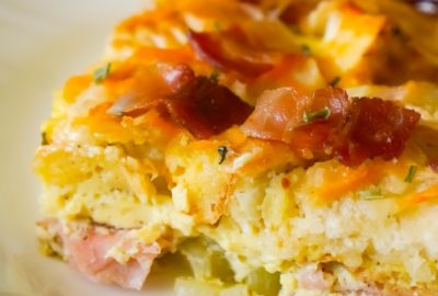 Bagel Breakfast Casserole with Eggs, Ham and Bacon is an easy brunch recipe made with chopped plain bagels loaded with eggs, sliced honey ham and crumbled bacon.