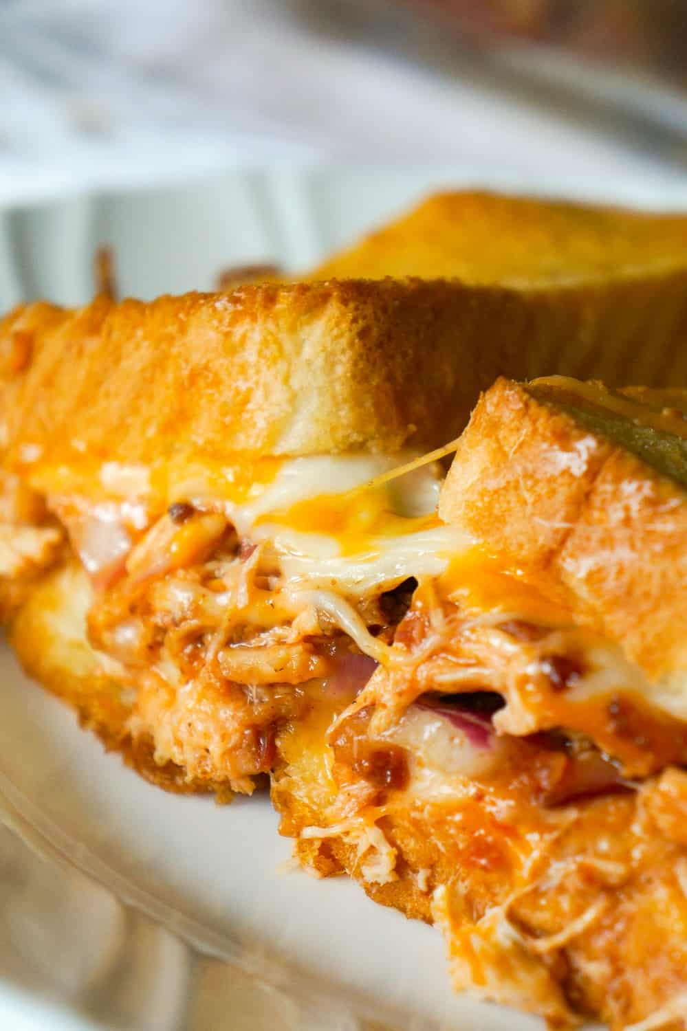 BBQ Chicken Grilled Cheese Casserole is an easy weeknight dinner recipe using shredded rotisserie chicken and loaded with BBQ sauce, bacon, cheddar and mozzarella.