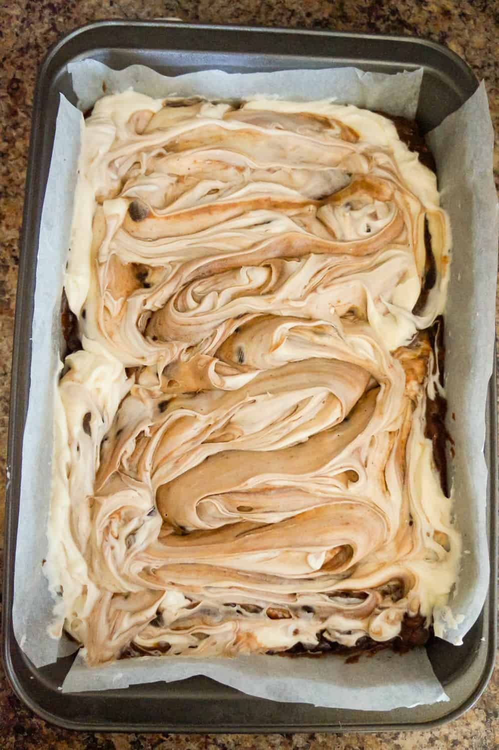 brownies with cream cheese swirl in pan before baking