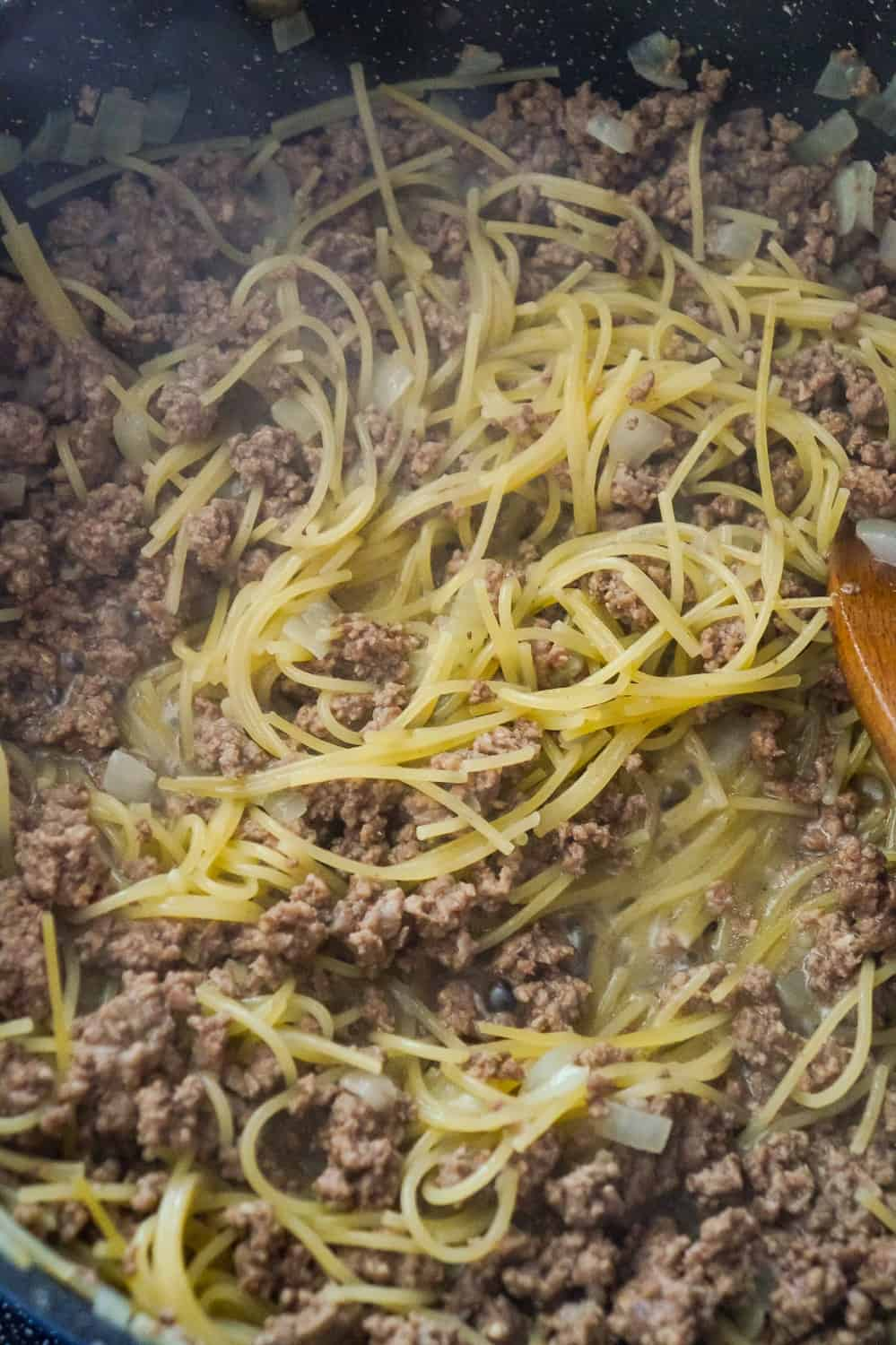 cooked spaghetti and ground beef in a pan