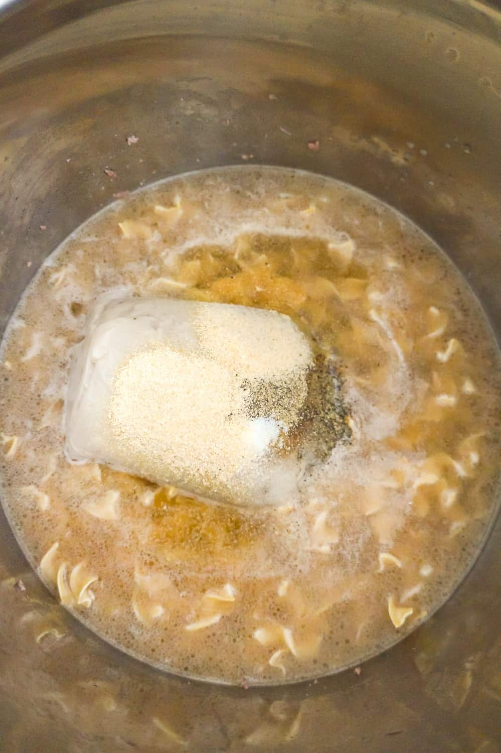 condensed cream of mushroom soup, spices, egg noodles and liquid in an Instant POt