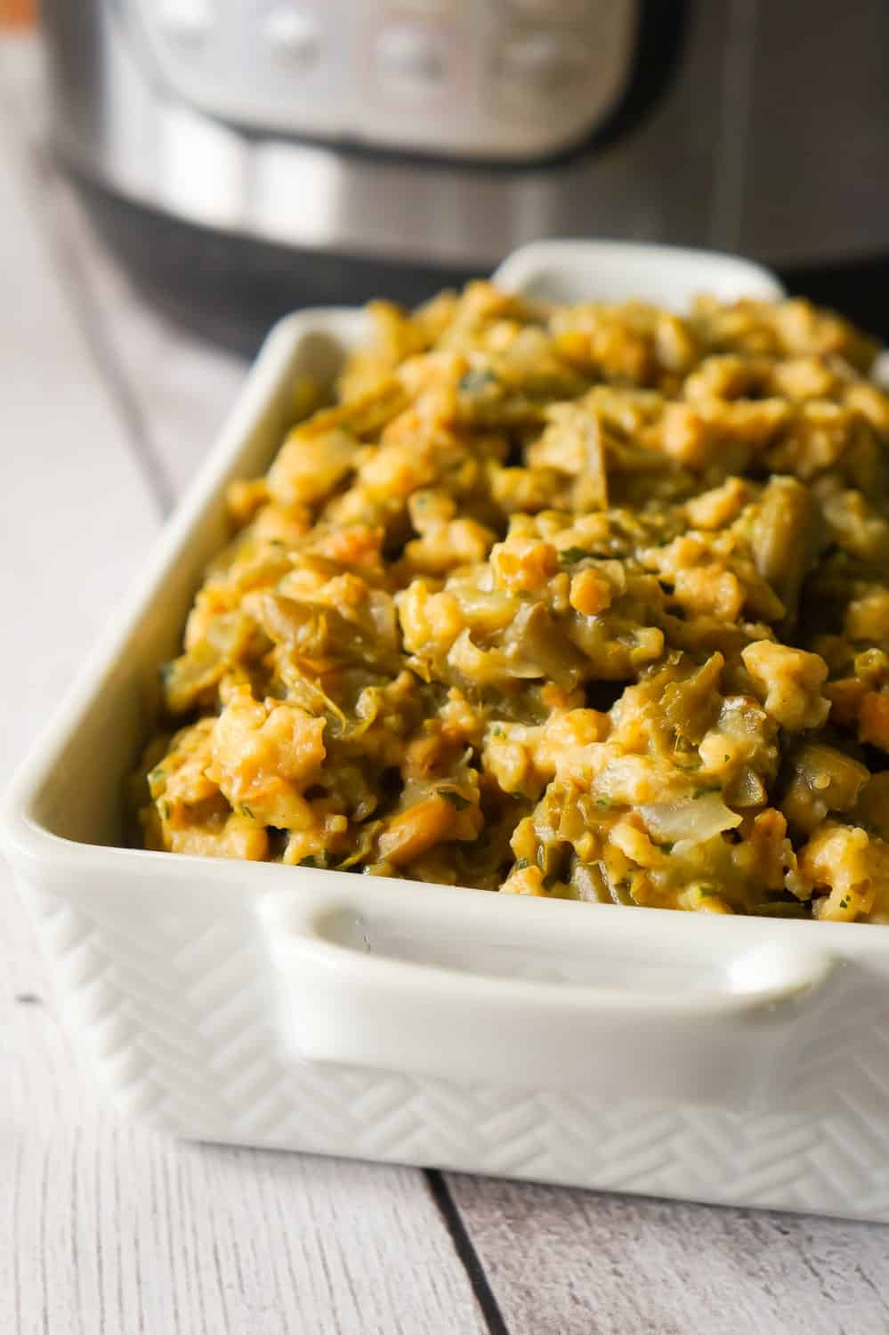 Instant Pot Green Bean Casserole with Stuffing is an easy pressure cooker side dish recipe made with cut green beans, cream of mushroom soup and Stove Top stuffing mix.