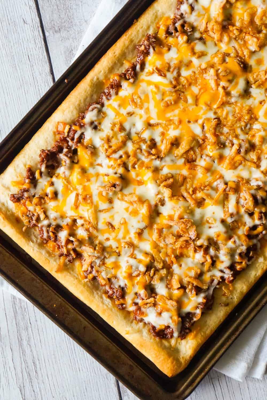 Sloppy Joe Pizza is an easy ground beef dinner recipe using Pillsbury pizza crust and homemade sloppy joe sauce.