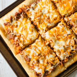 Sloppy Joe Pizza is an easy ground beef dinner recipe using Pillsbury pizza crust and homemade sloppy joe sauce.