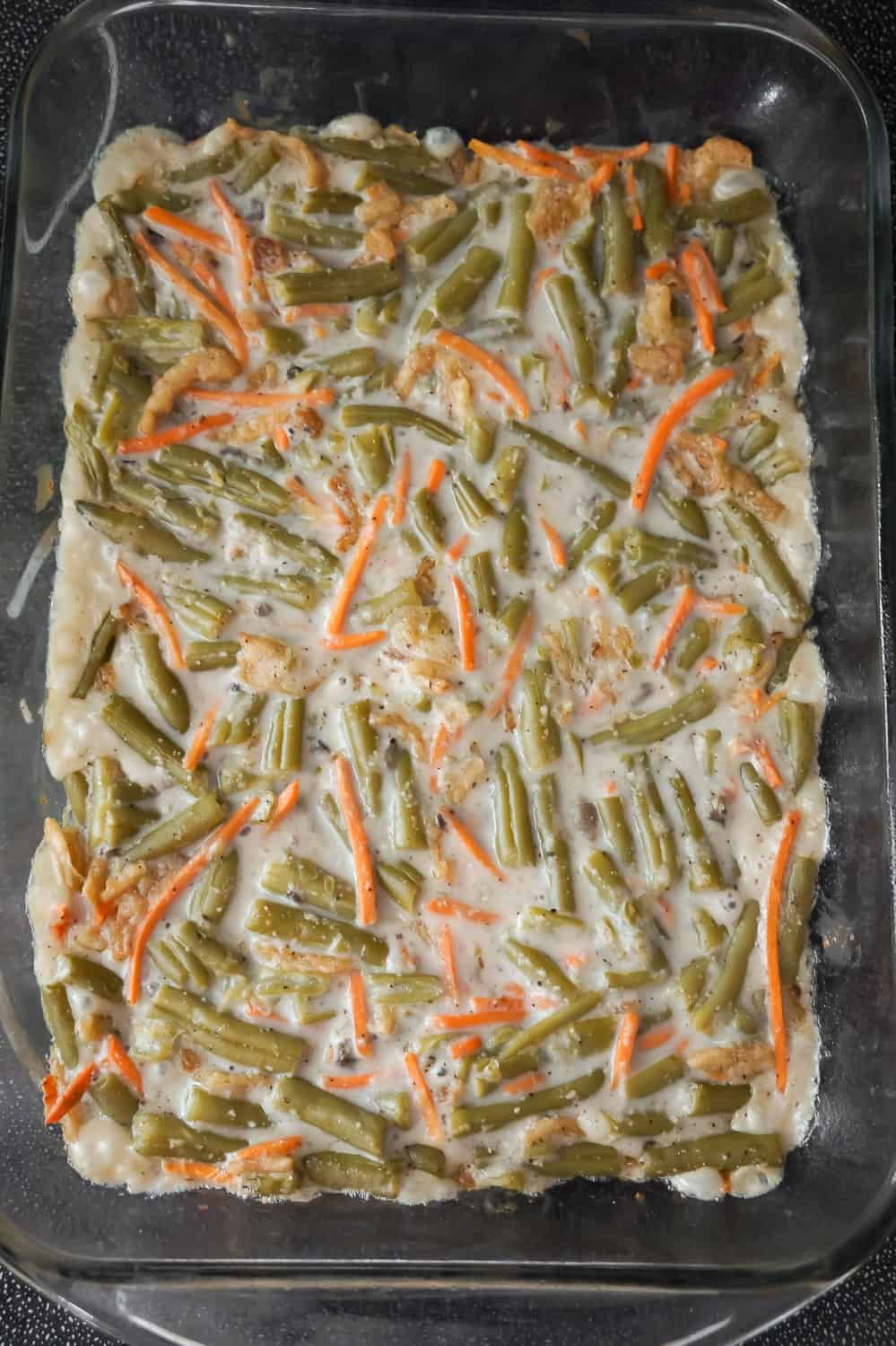 green beans, carrots and mushrooms soup mixture in a 9 x 13 inch baking dish