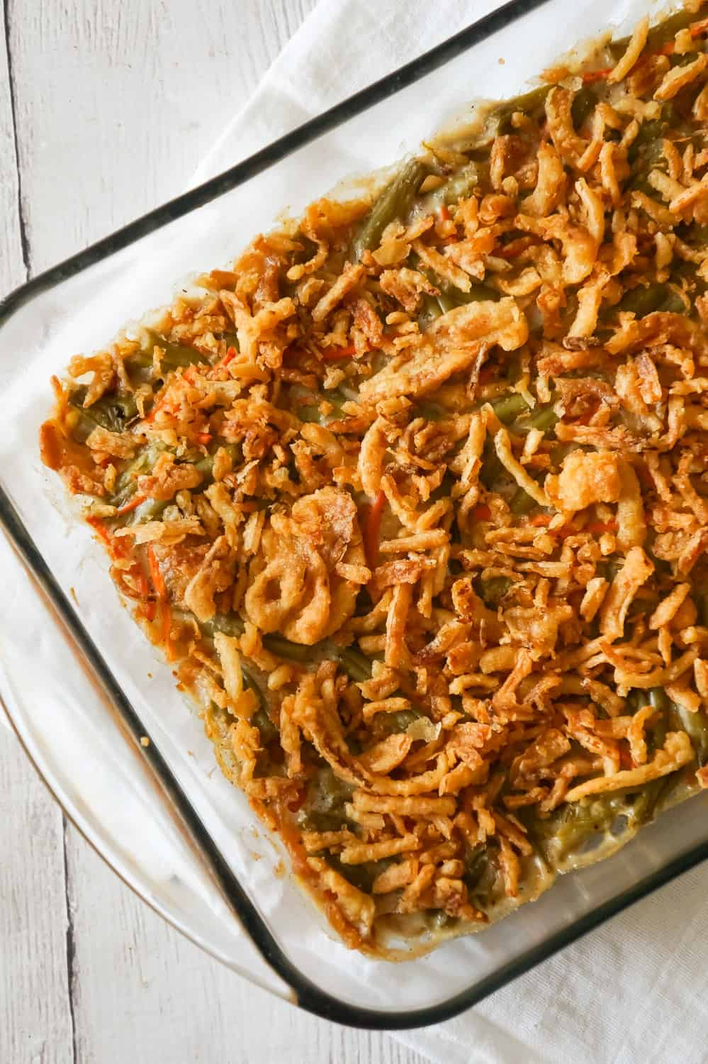 Green Bean Casserole with Campbell's Soup is a simple and delicious side dish recipe made with canned green beans, matchstick carrots, cream of mushroom soup and French's fried onions.