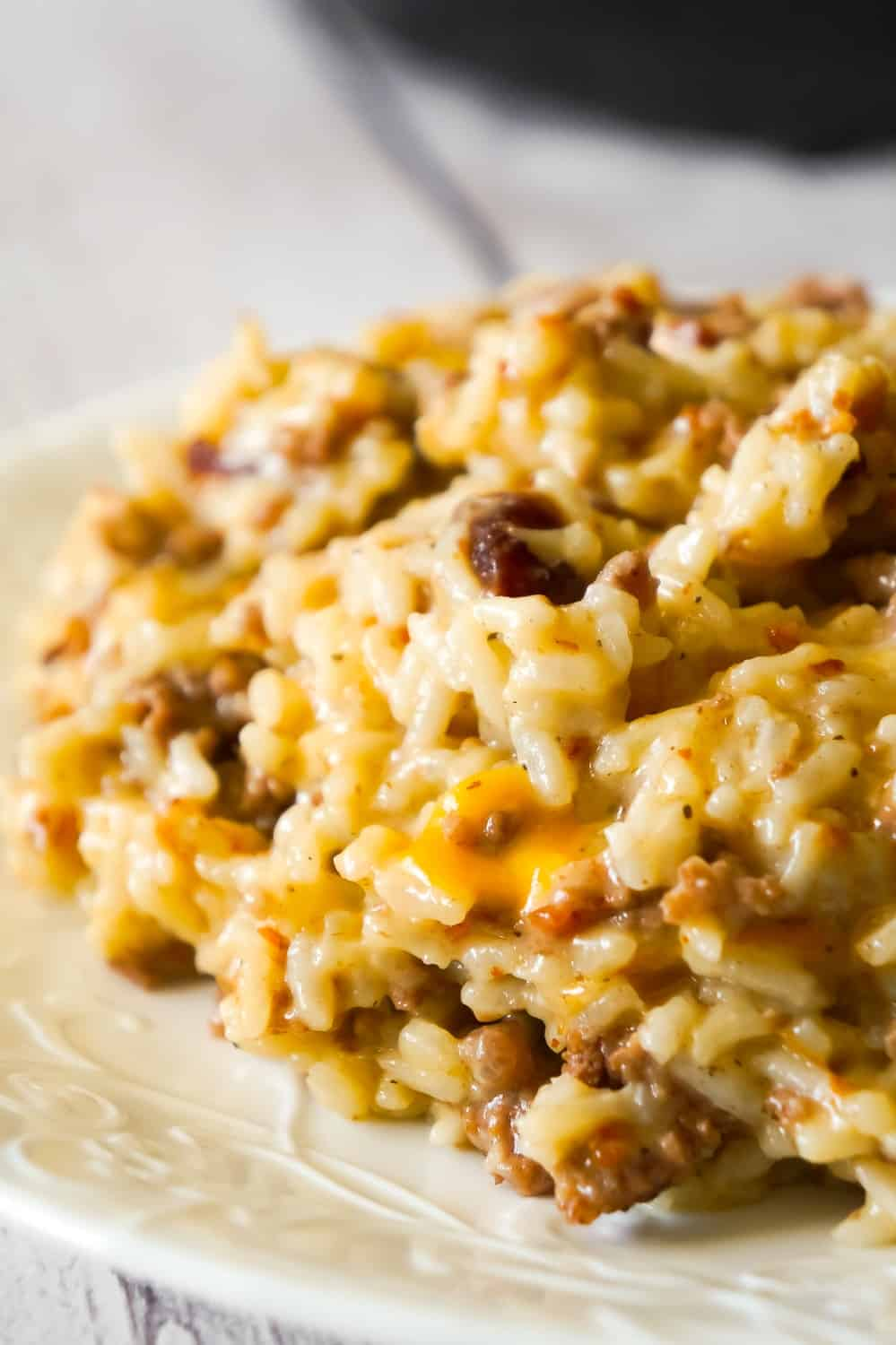 Instant Pot Bacon Cheeseburger Rice is a delicious pressure cooker dinner recipe using hamburger meat and loaded with long grain rice, crumbled bacon and cheese.