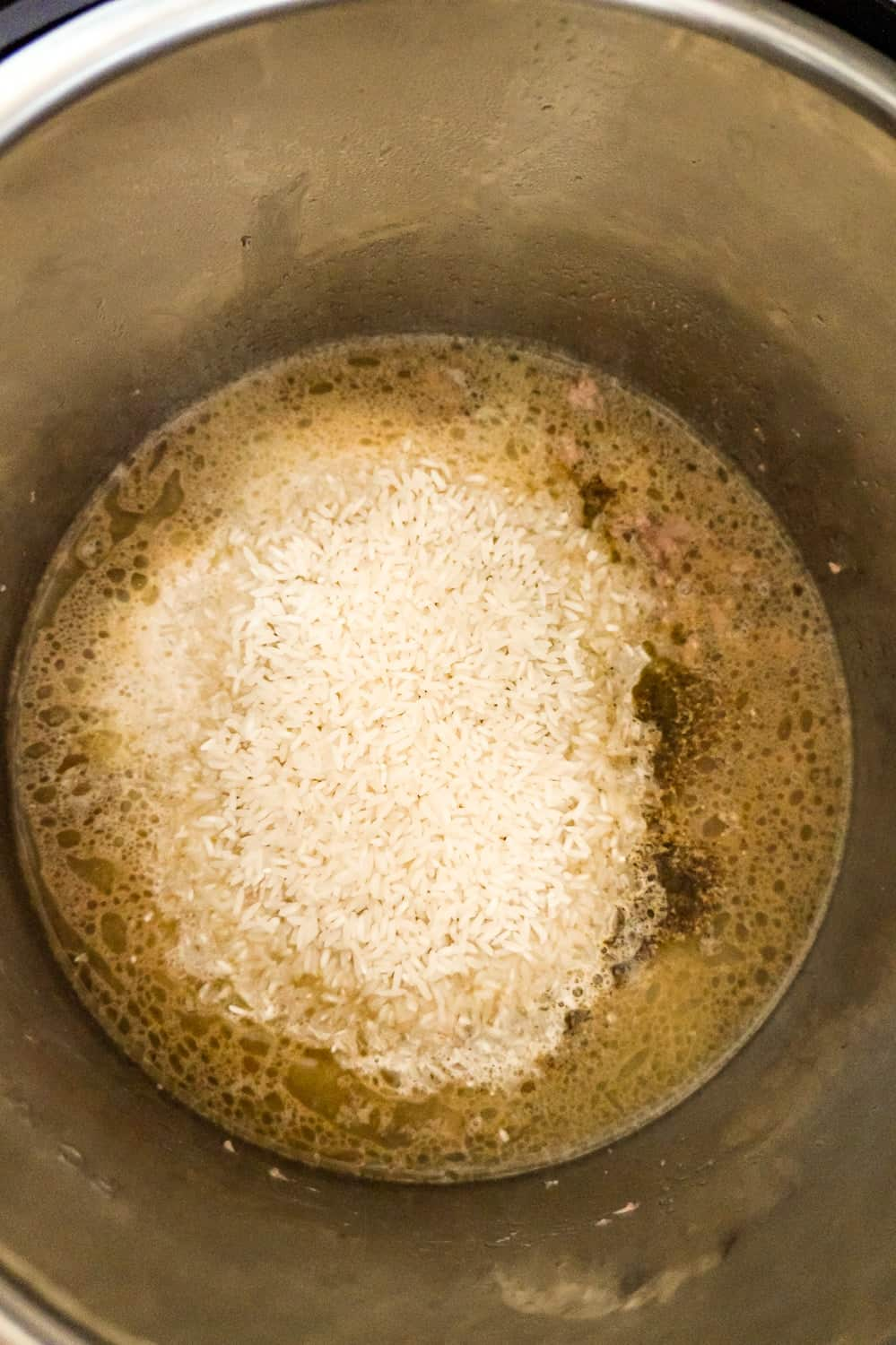 long grain white rice on top of ground beef in an Instant Pot