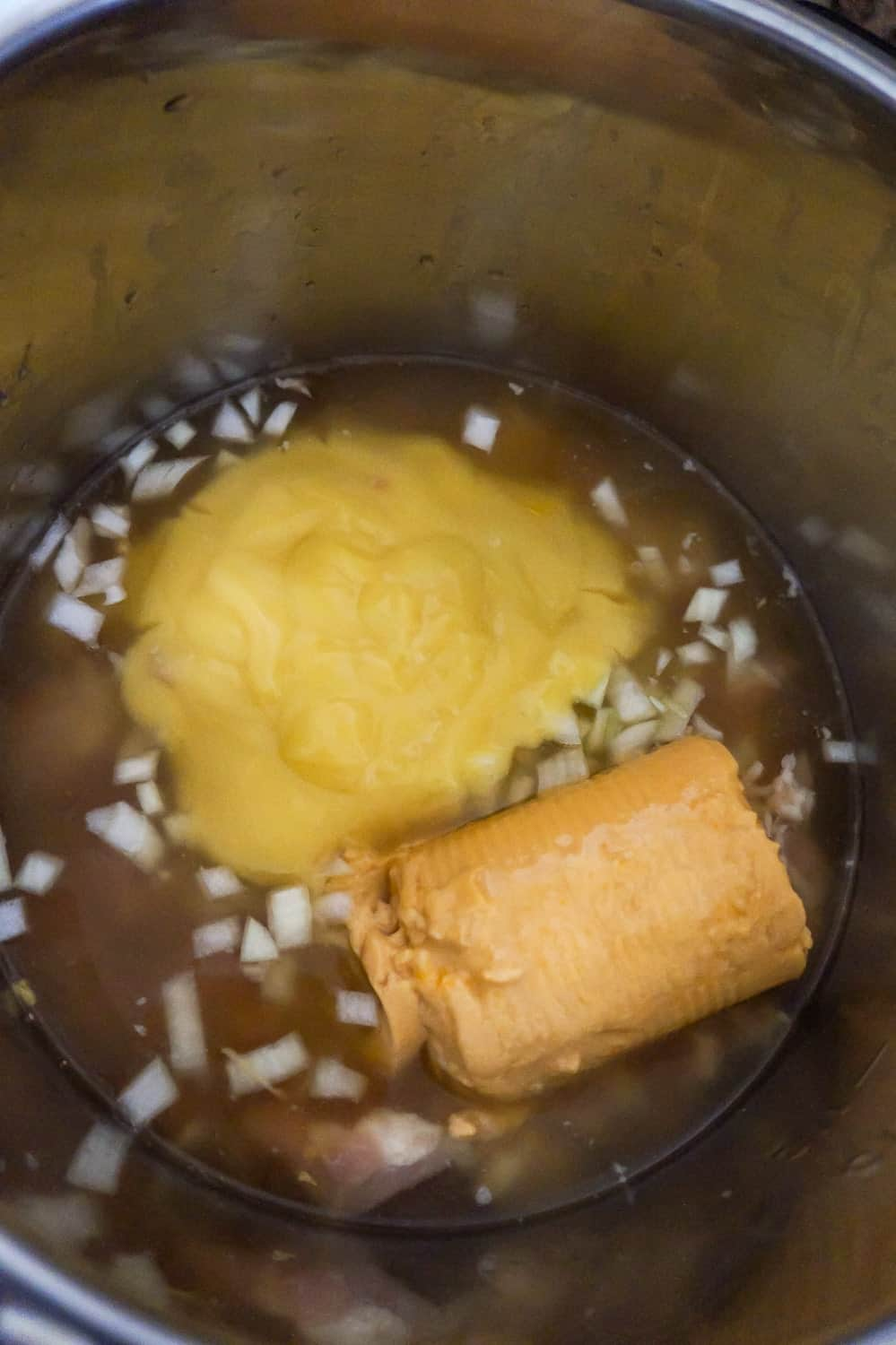 cream of chicken soup, cheddar cheese soup and chicken broth in an Instant Pot