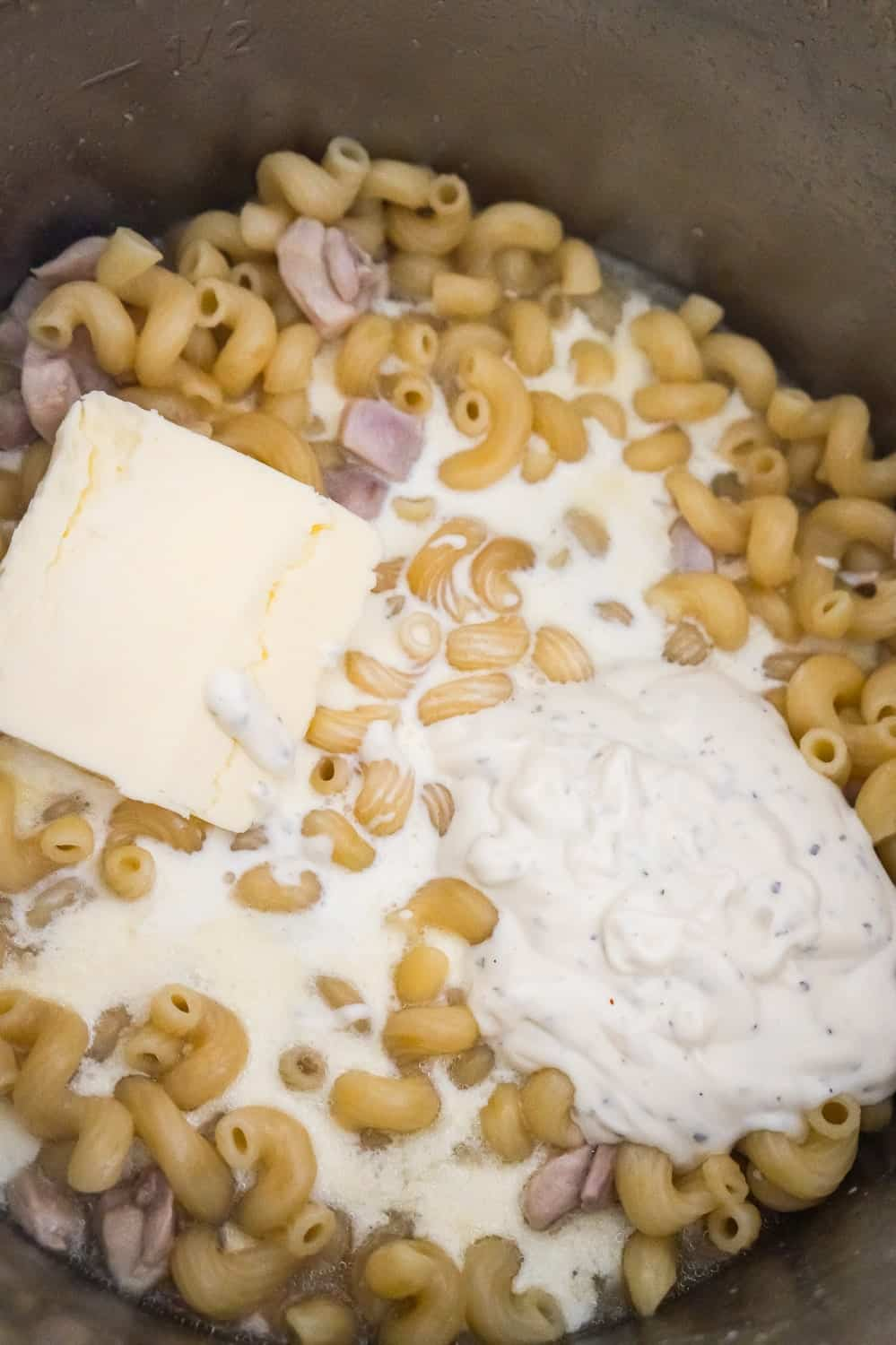 butter, ranch dressing and heavy cream on top of pasta in an Instant Pot