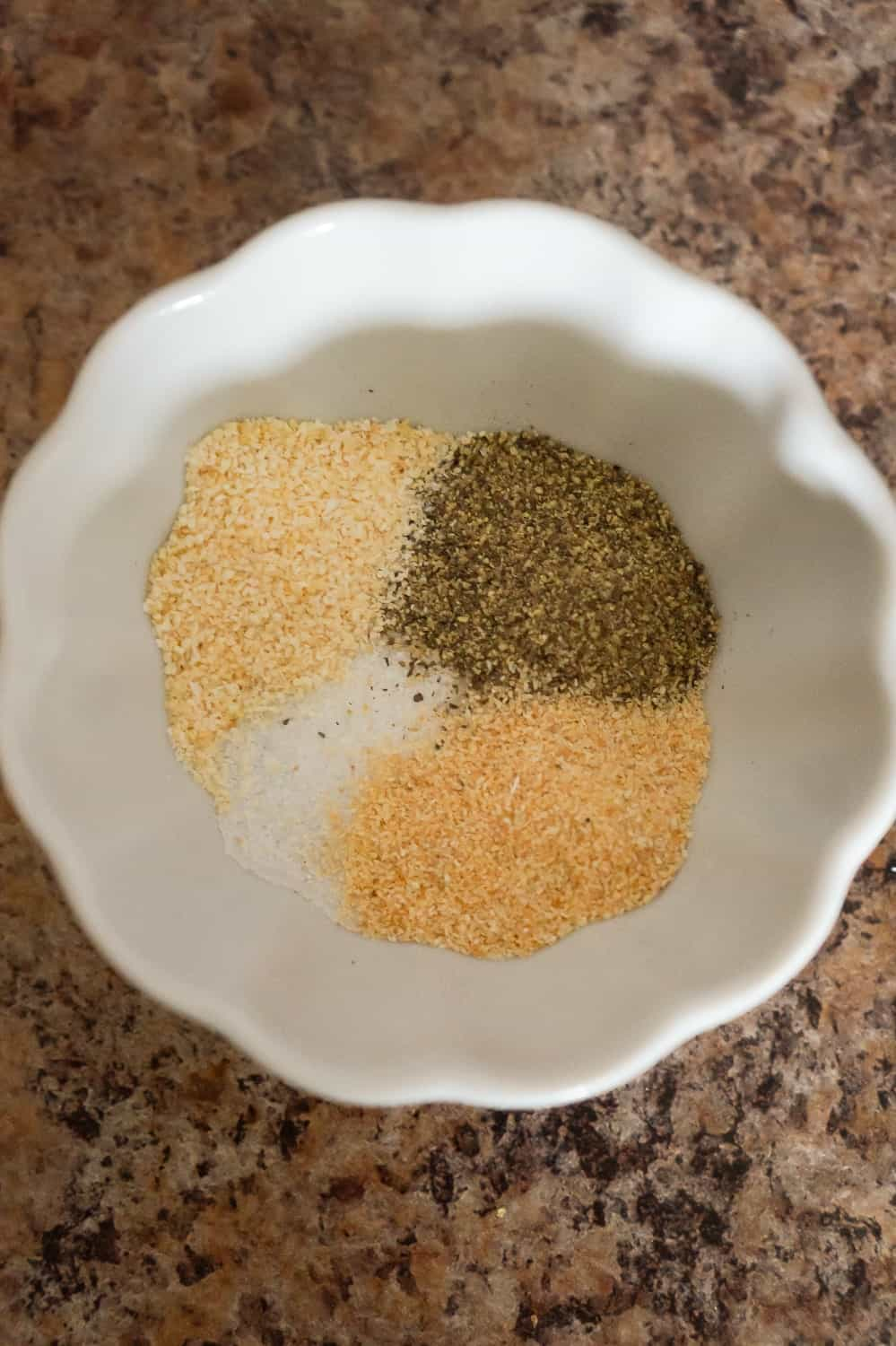 garlic powder, onion powder, salt and pepper in a small bowl