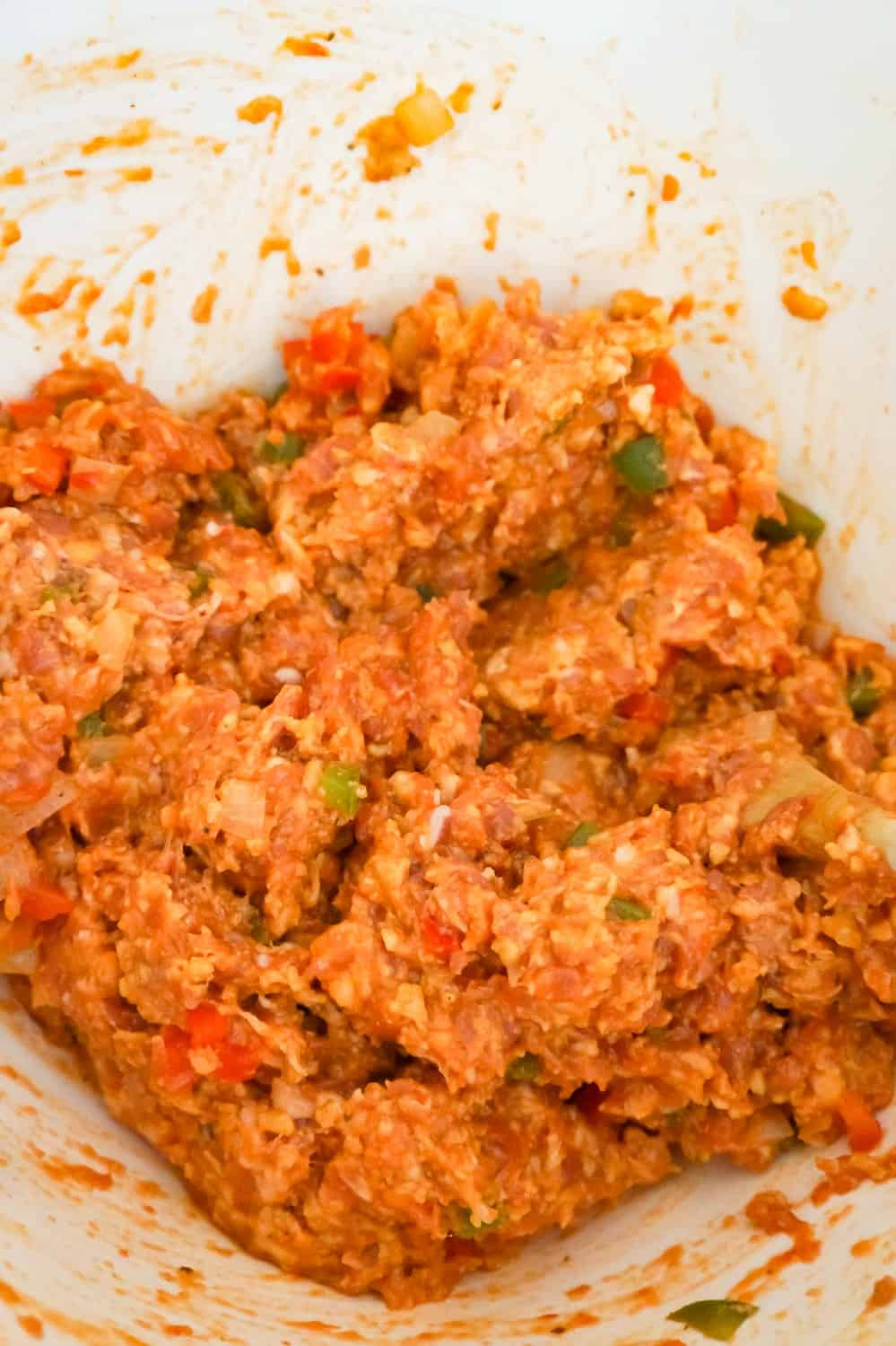 sausage meat mixture in a mixing bowl
