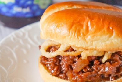 Grape Jelly BBQ Sloppy Joes are a fun twist on the classic sandwich. These tasty sloppy joes are made with ground beef tossed in a mixture of grape jelly and BBQ sauce and topped with French's crispy fried onions.