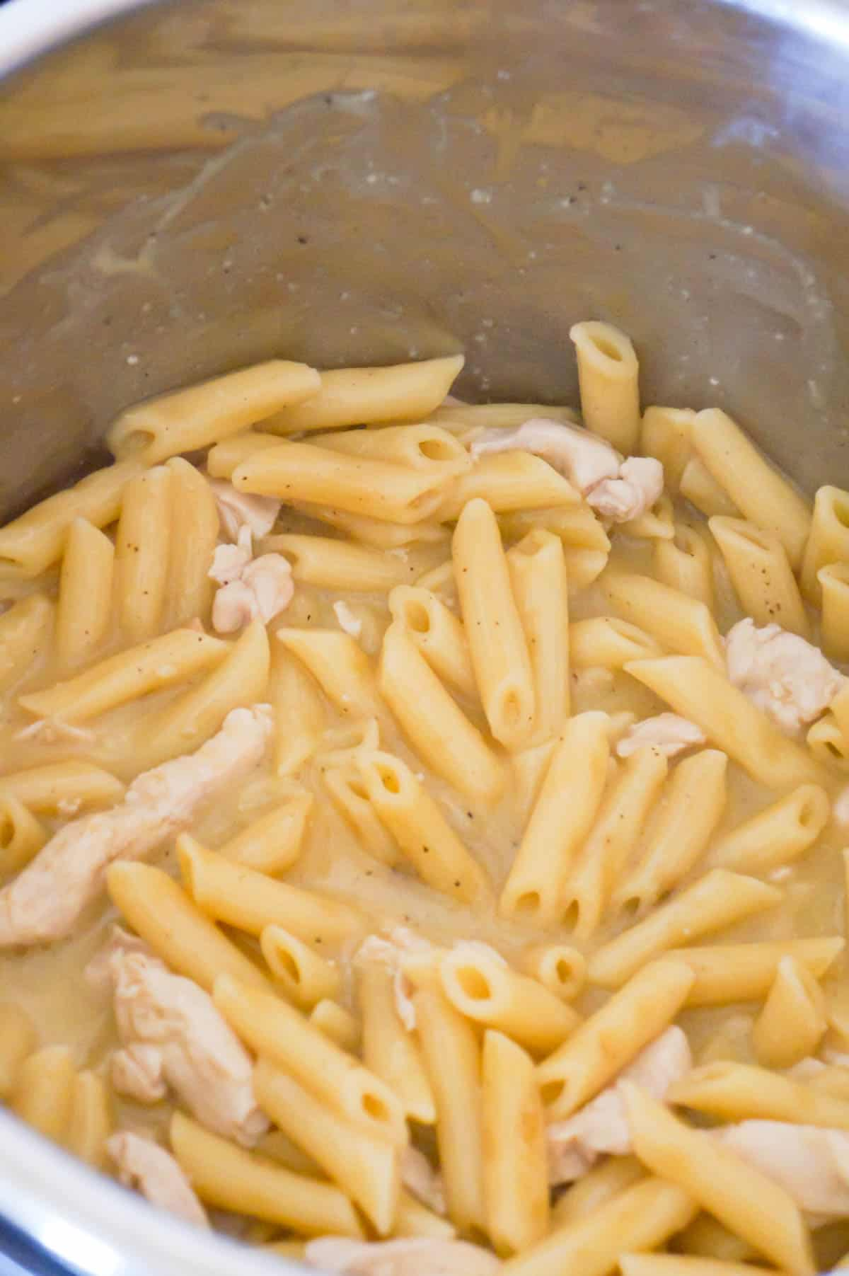 cooked penne pasta and chicken breast strips in an Instant Pot