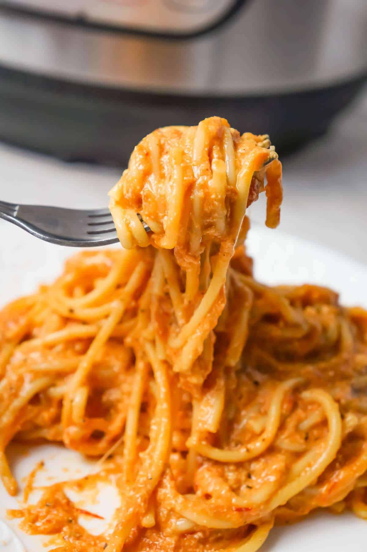 Instant Pot Spaghetti with Ricotta is an easy weeknight dinner recipe made with canned marinara sauce and loaded with mozzarella, cheddar and ricotta cheese.