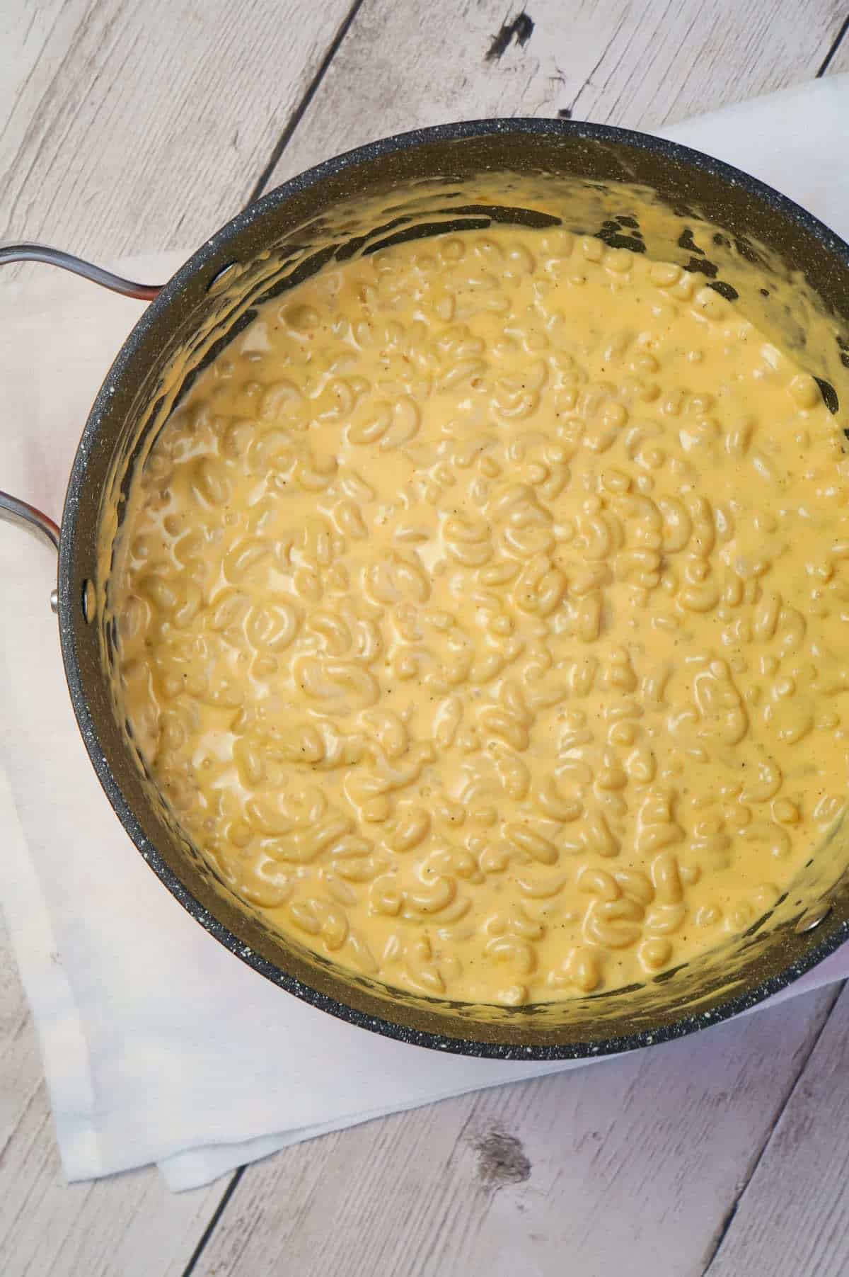 Creamy Stovetop Mac and Cheese is an easy and delicious homemade macaroni and cheese recipe made with cheddar cheese soup, heavy cream, mozzarella and cheddar cheese.