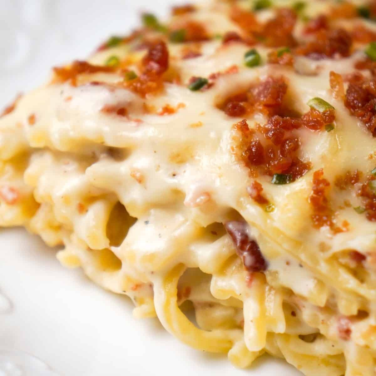 Bacon Cream Cheese Baked Spaghetti is a delicious pasta recipe loaded with crumbled bacon, Philadelphia Whipped Chive cream cheese and mozzarella cheese.