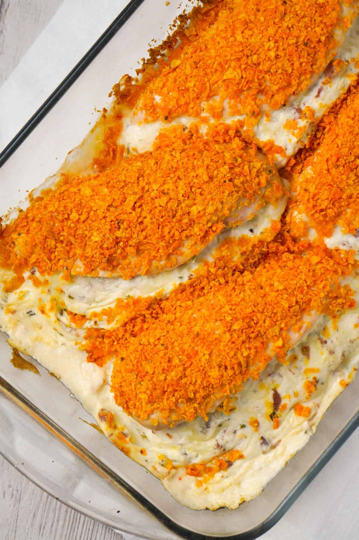 Cream Cheese and Bacon Stuffed Doritos Chicken is a delcious stuffed chicken breast recipe made with chive and onion cream cheese, cream of bacon soup, cumbled bacon and crushed Doritos.